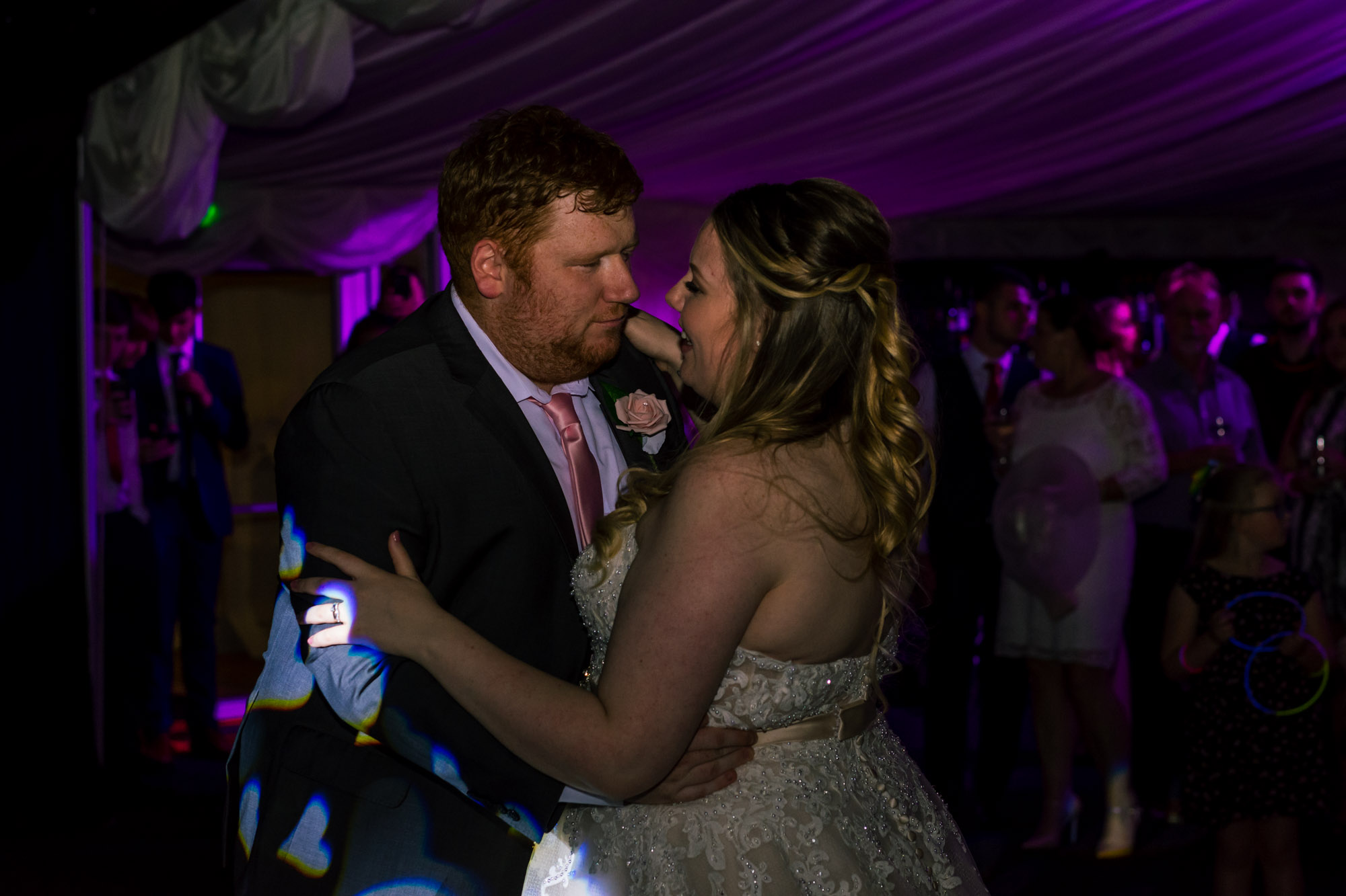 bride and groom go in for a kiss during the first dance
