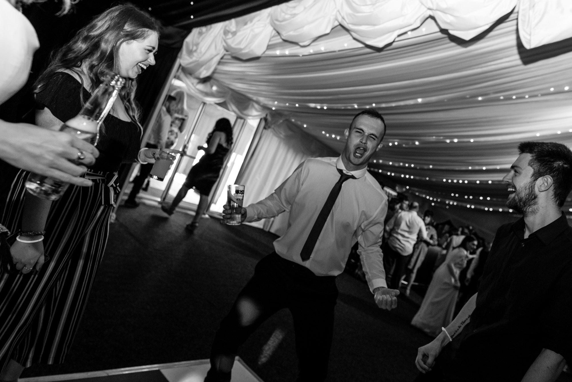 wedding guest having fun on the dance floor