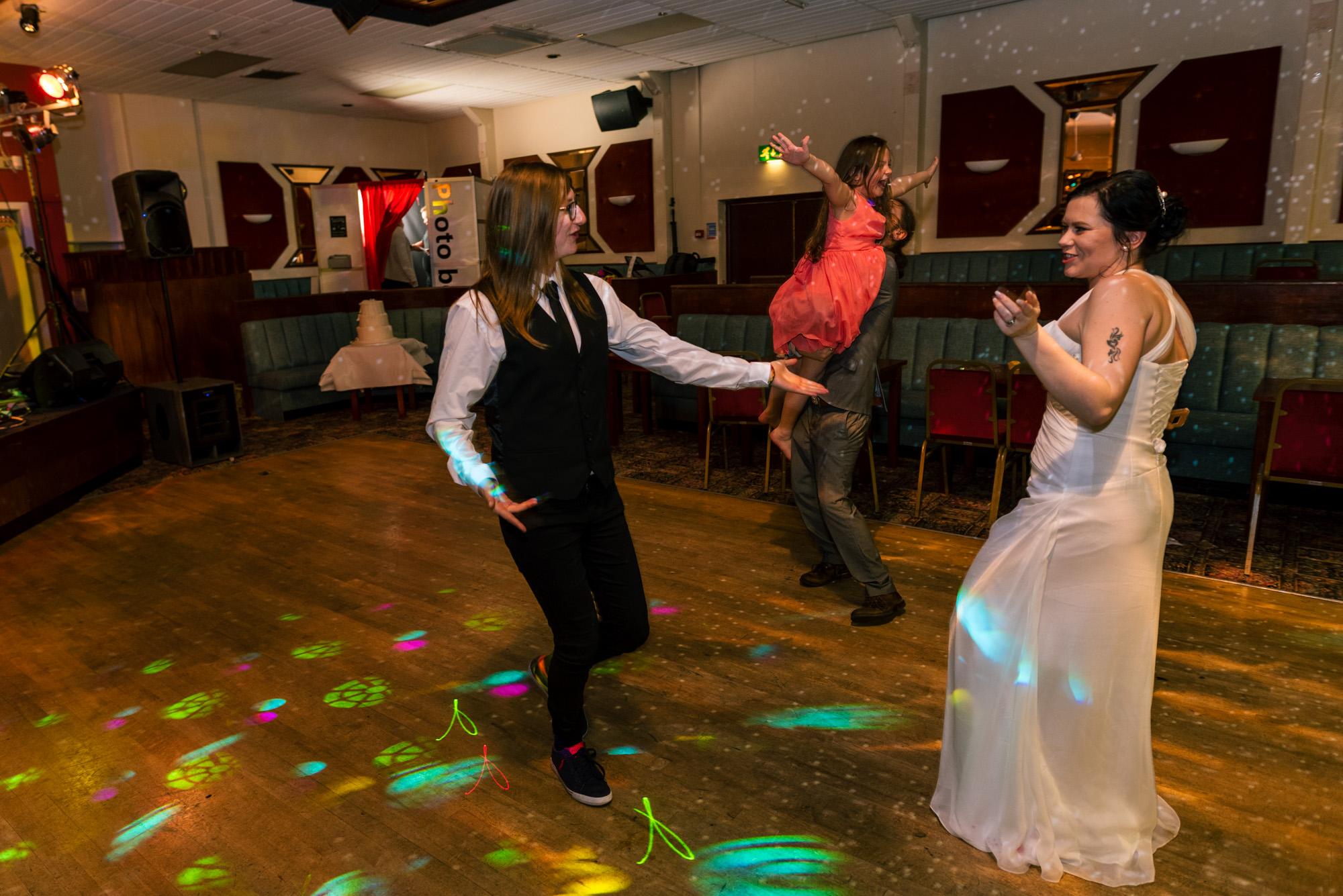 Bride and friends dancing on the dance floor.