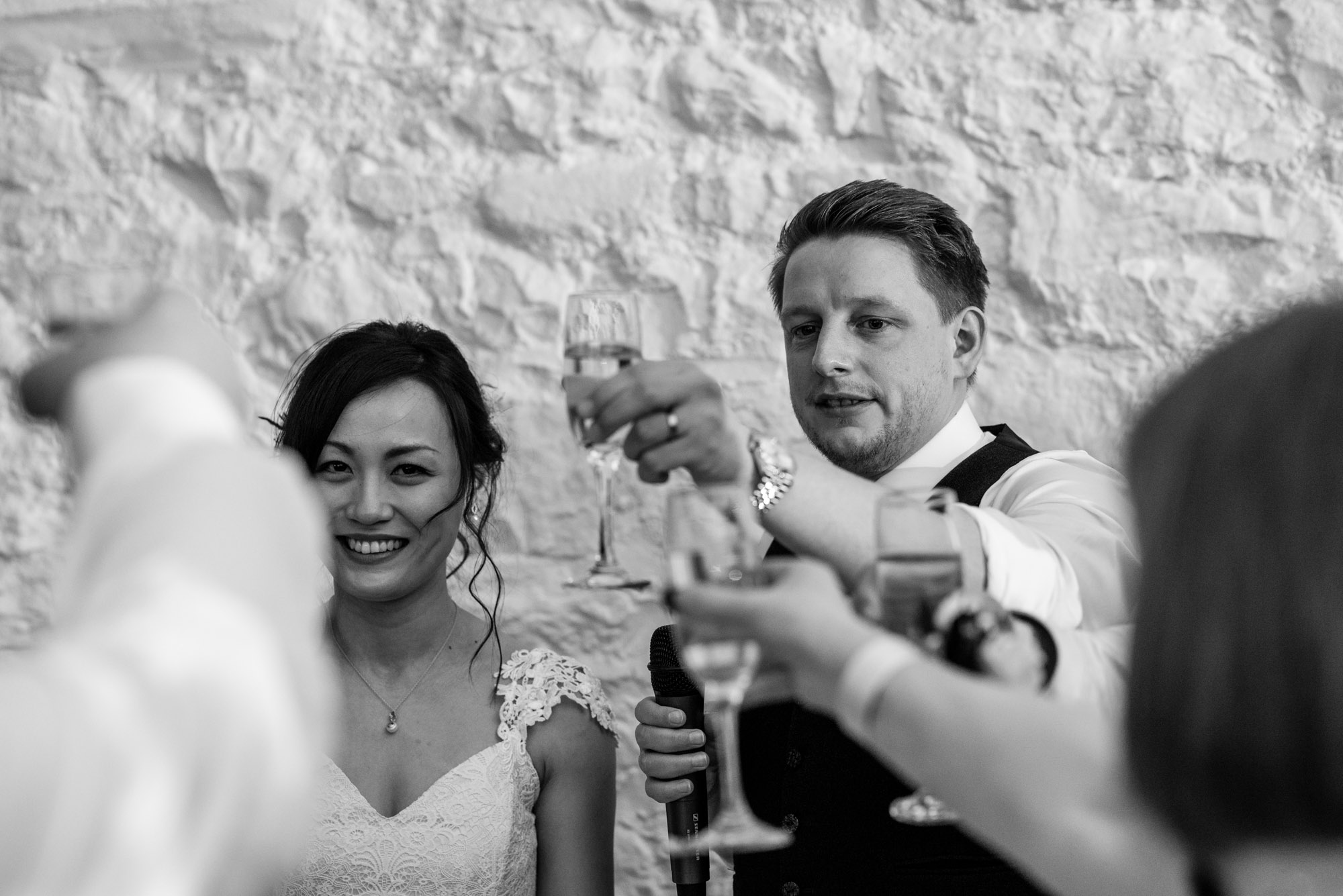 The bride and groom share a toast during the wedding speeches.