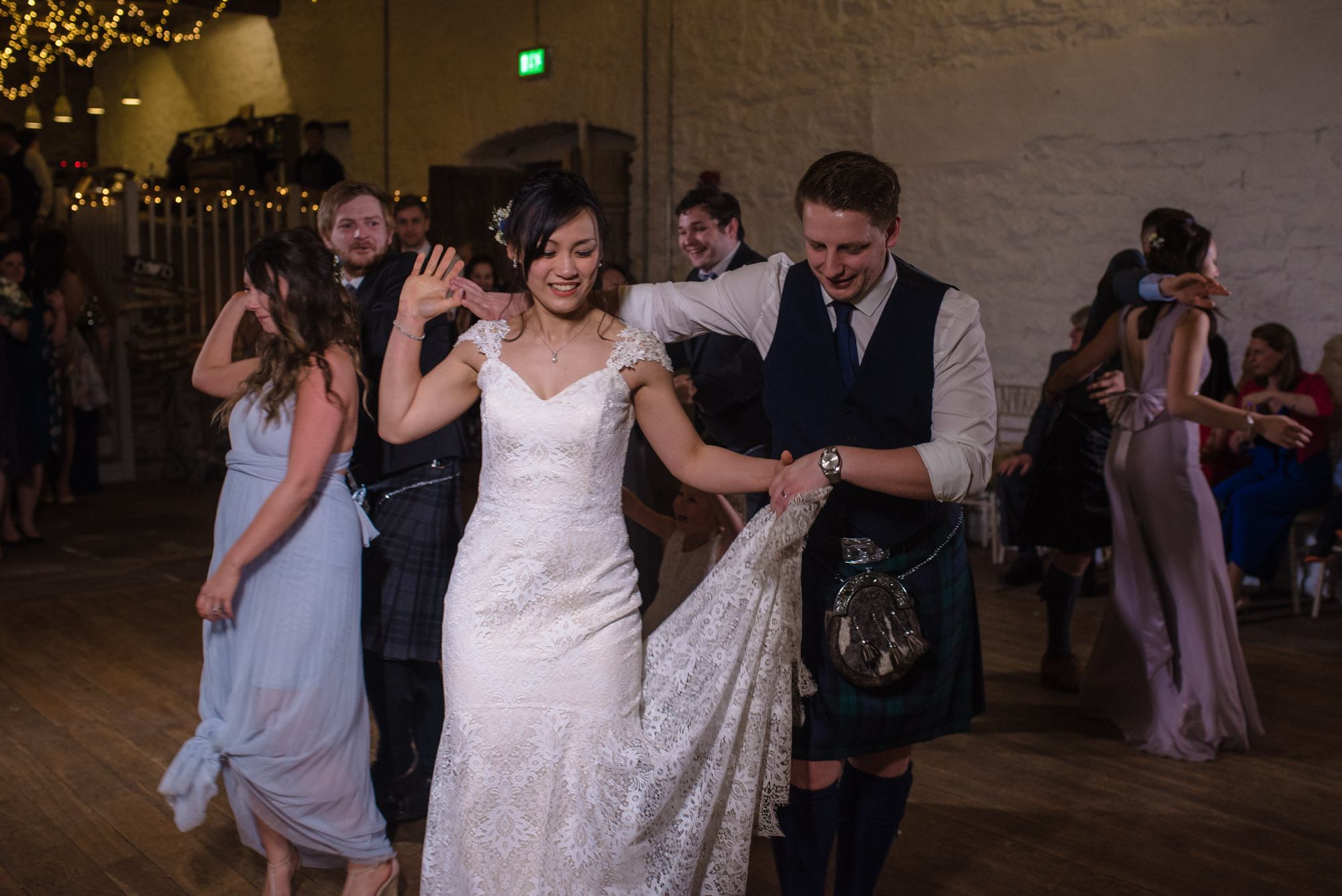 The bride and groom dance the gay Gordon's at Askham Hall.