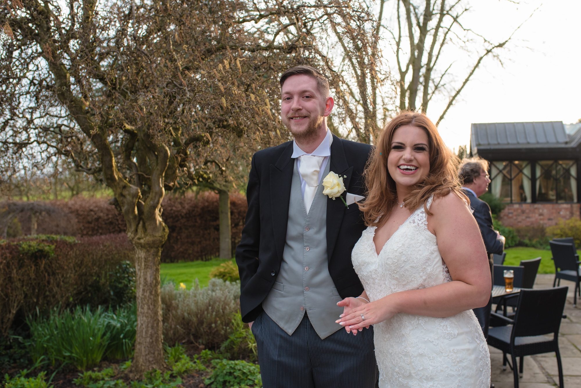 The bride and groom share a casual smile during their Shropshire wedding photography.