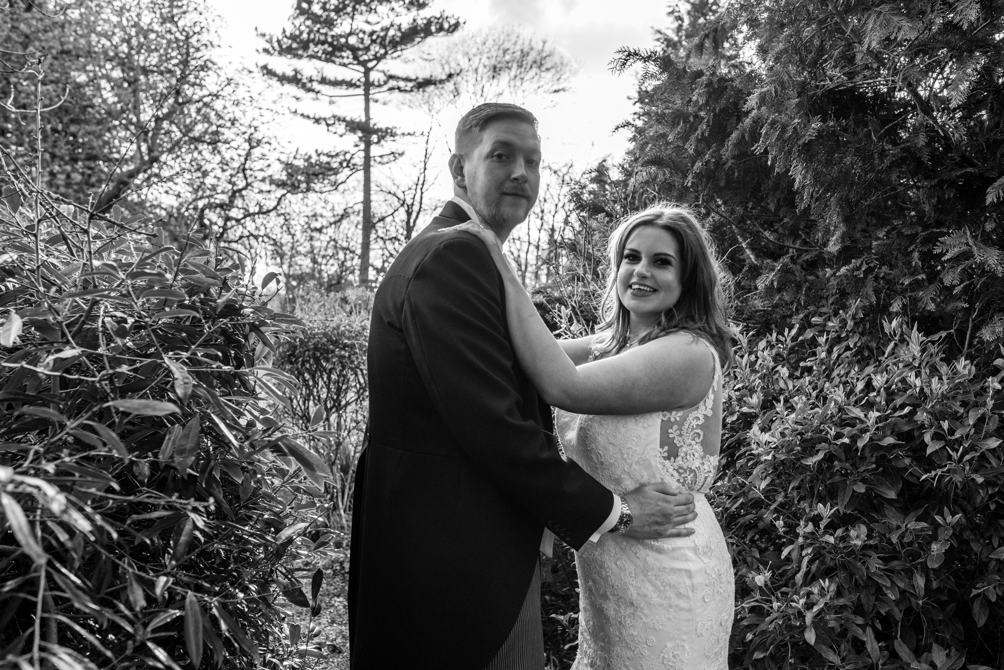Black and white image of a back lit bride and groom in Cheshire.