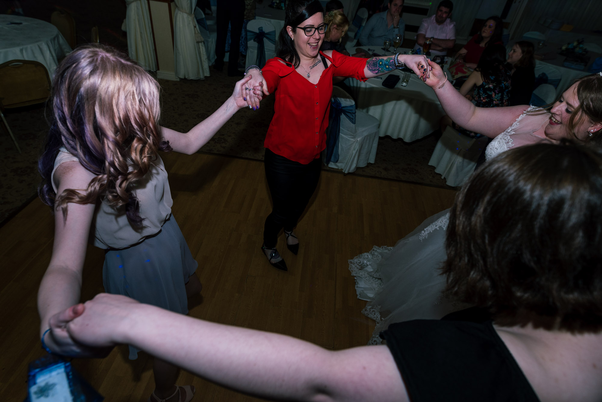 Guests dance with the bride