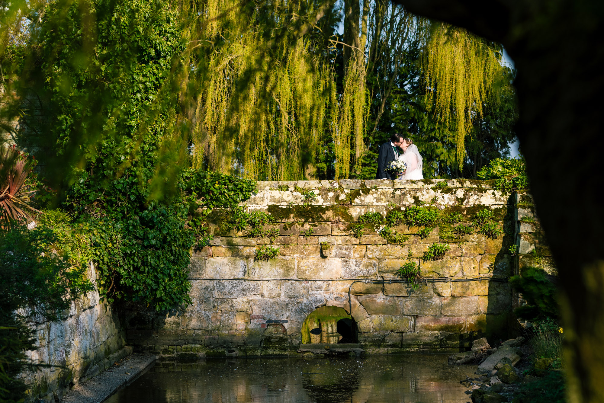 Bride and groom portraits on the bridge over the old moat