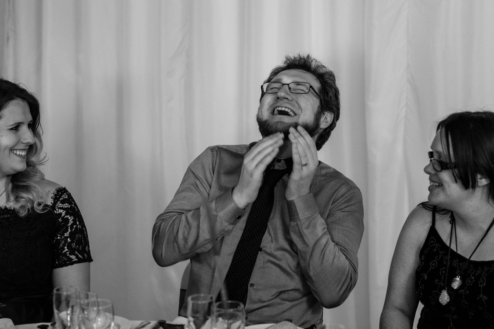 A guest enjoys a belly laugh