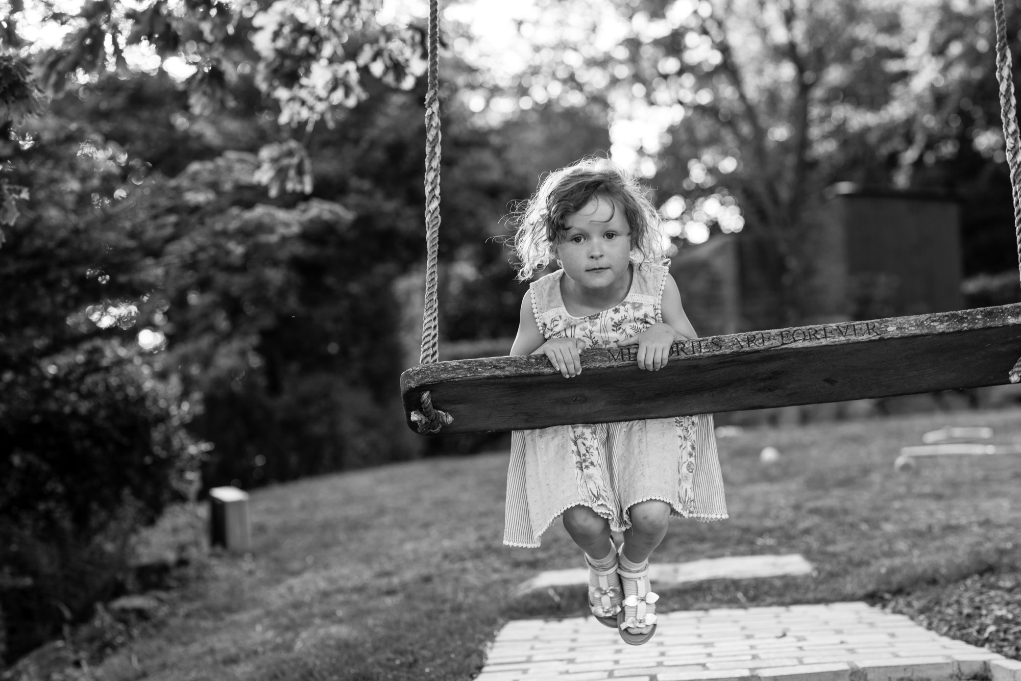 A young guest plays on the swing