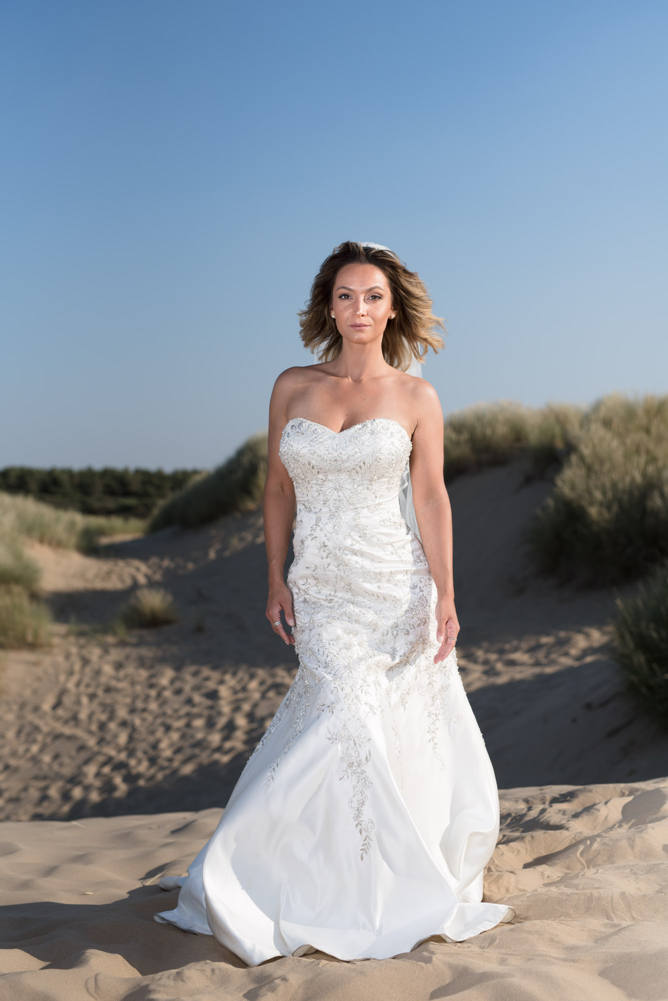 Brides dress on the beach