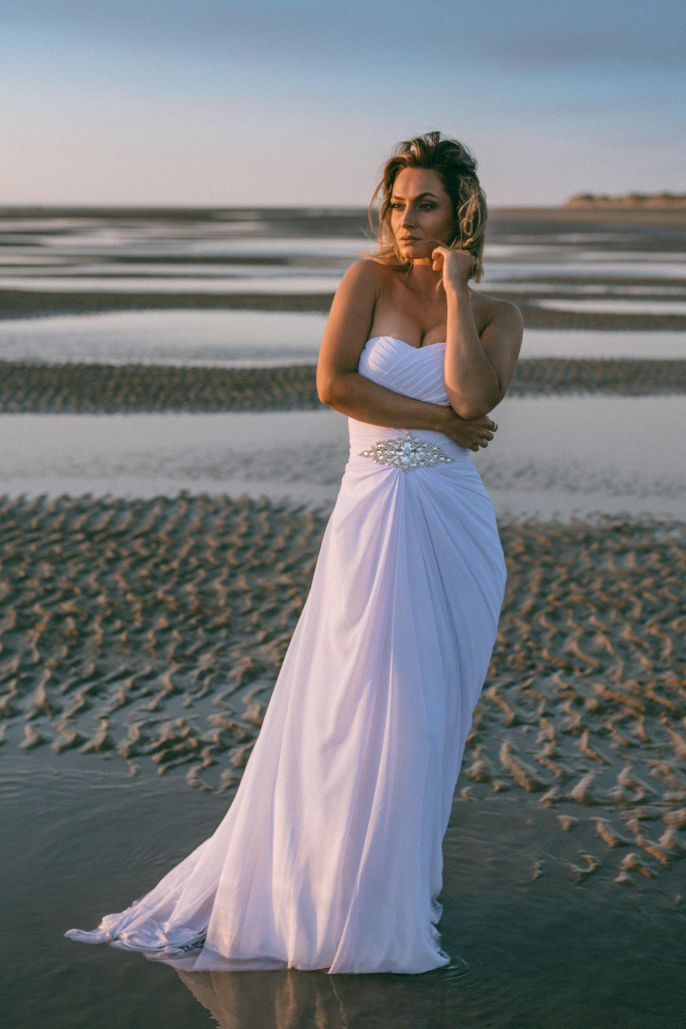 Bride standing in water