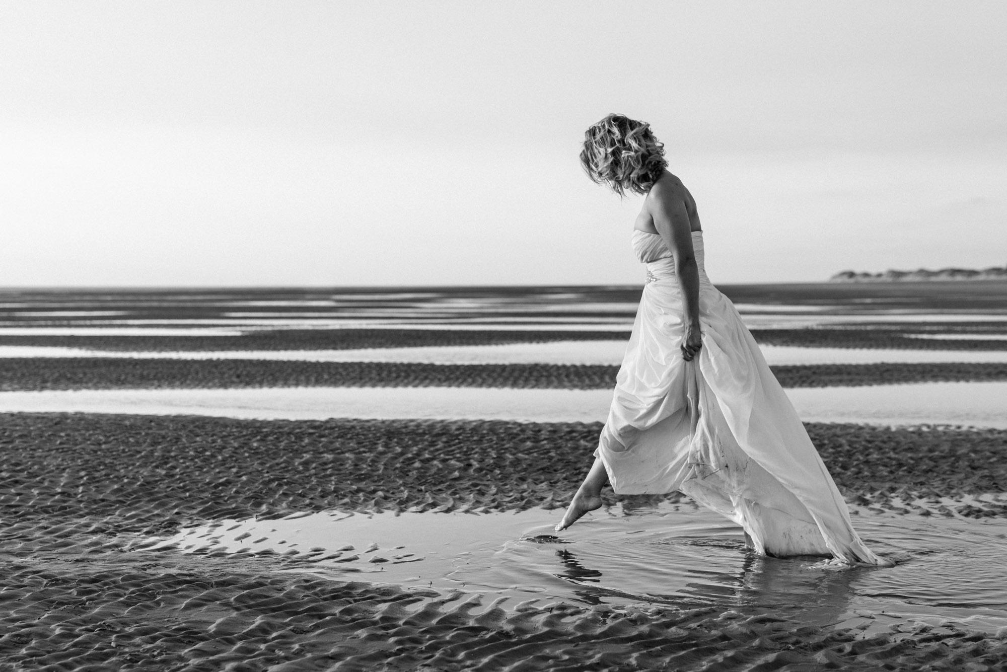 Bride walking through water