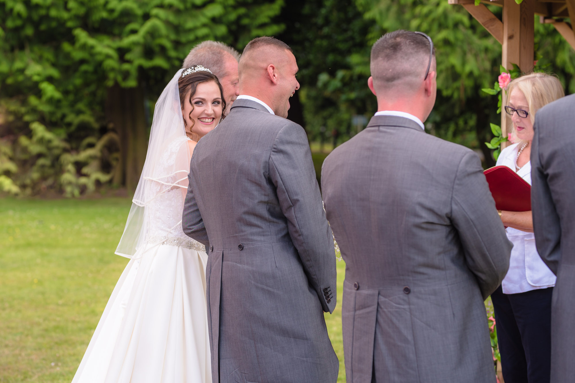Bride smiles at her guests