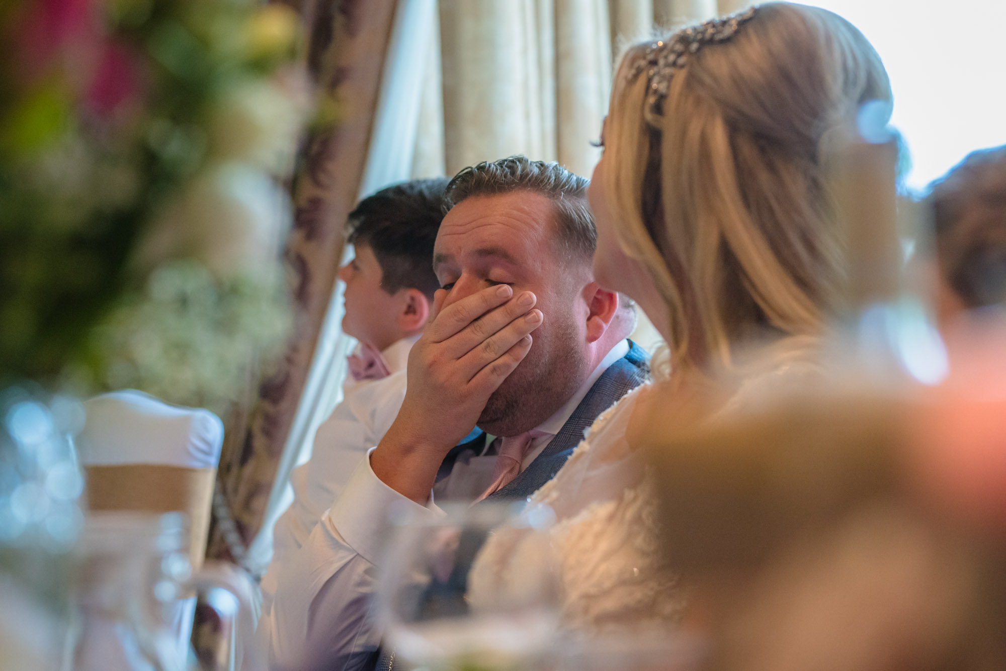Groom shows his emotions during the speeches
