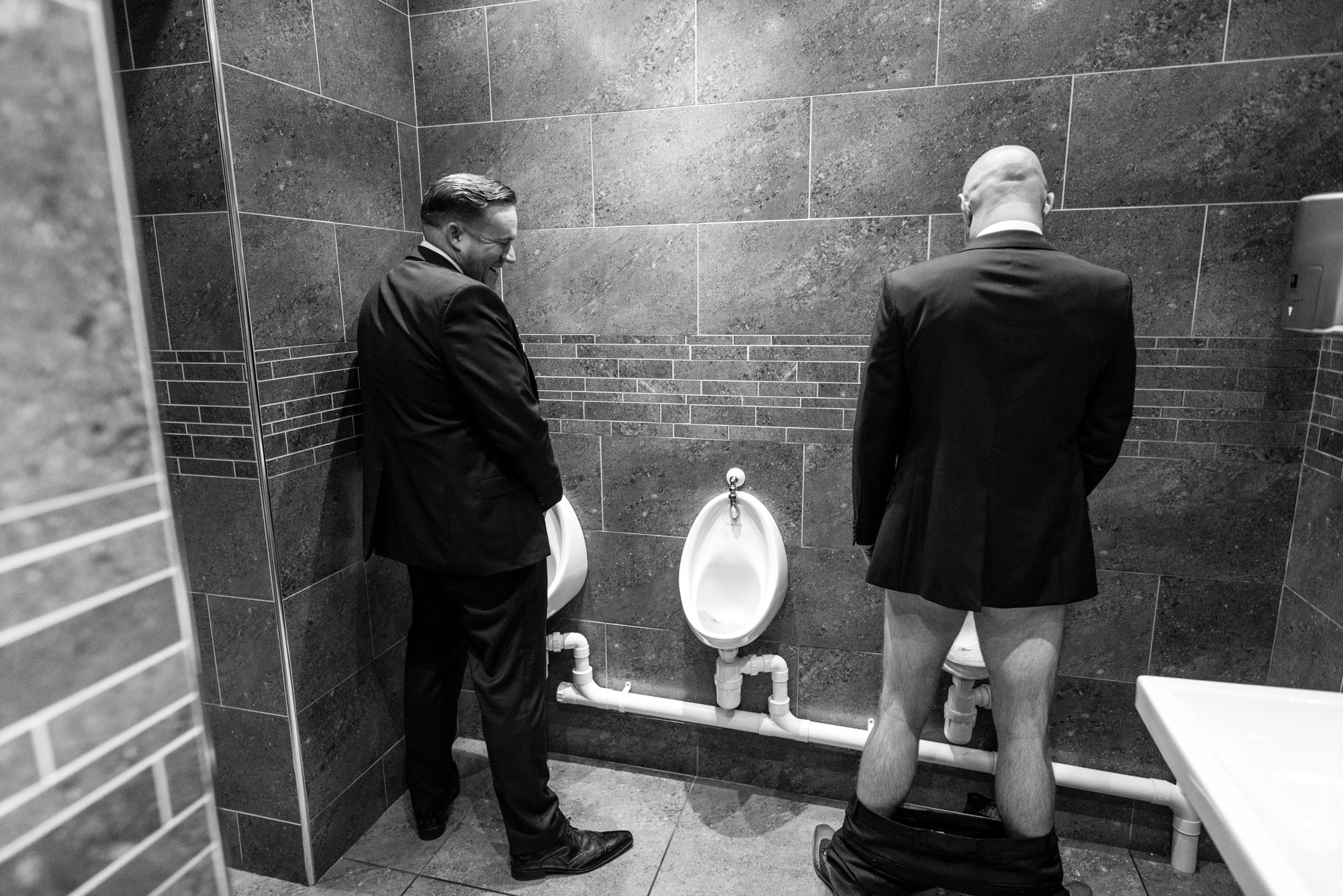 Two wedding guests in the toilet