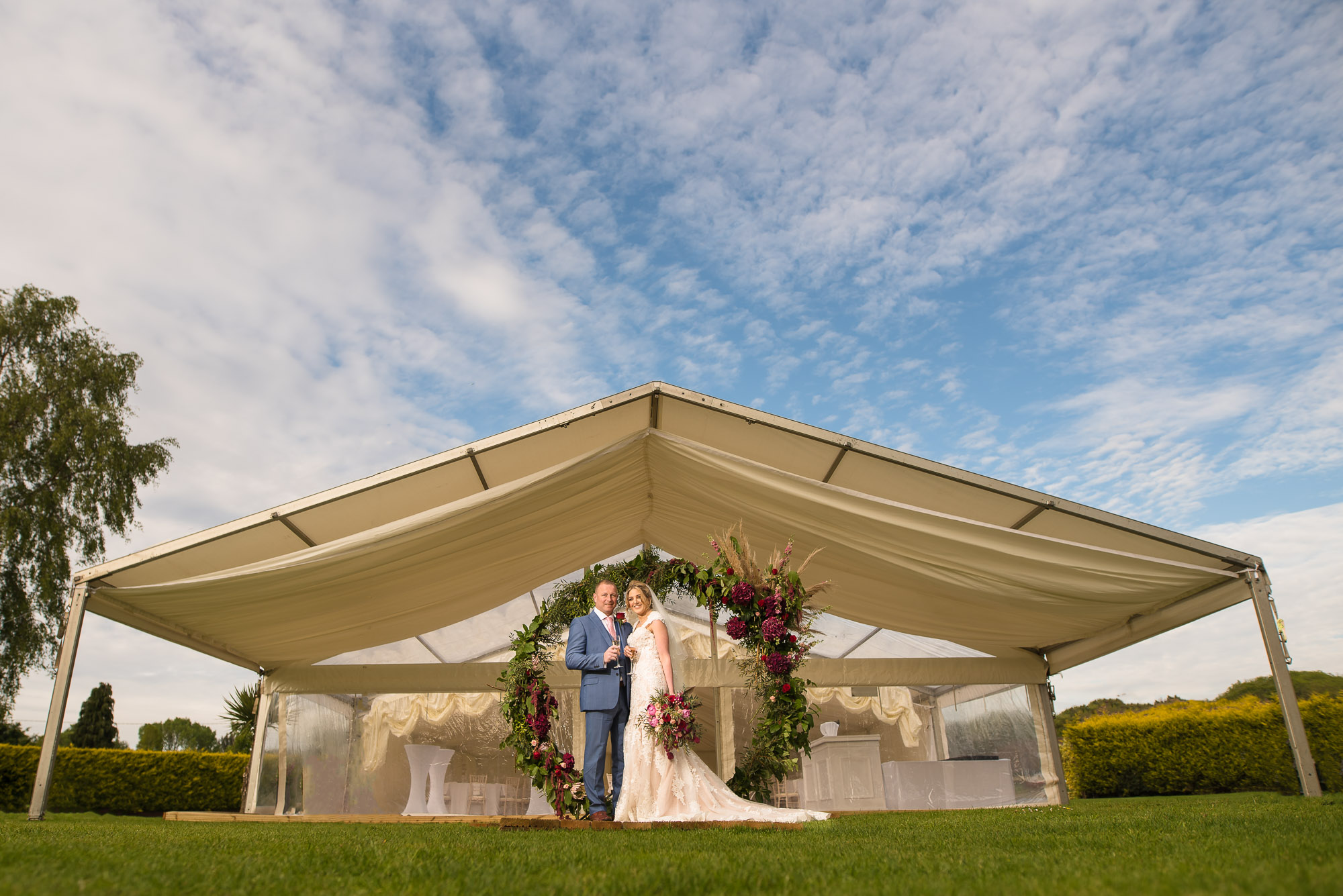 Bride and groom in front of the marquee