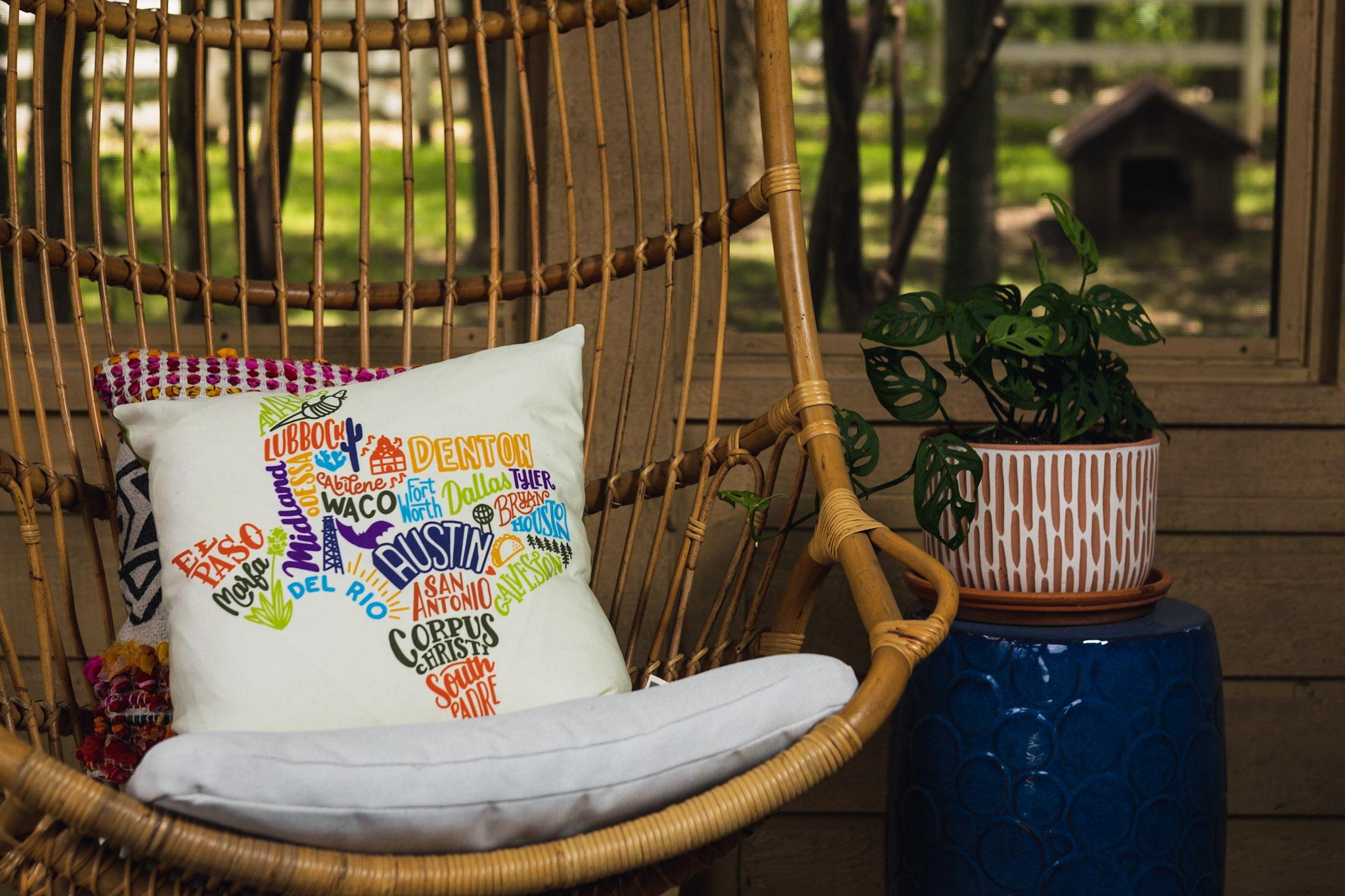 104-0617 Texas pillow on a swinging patio chair.jpg