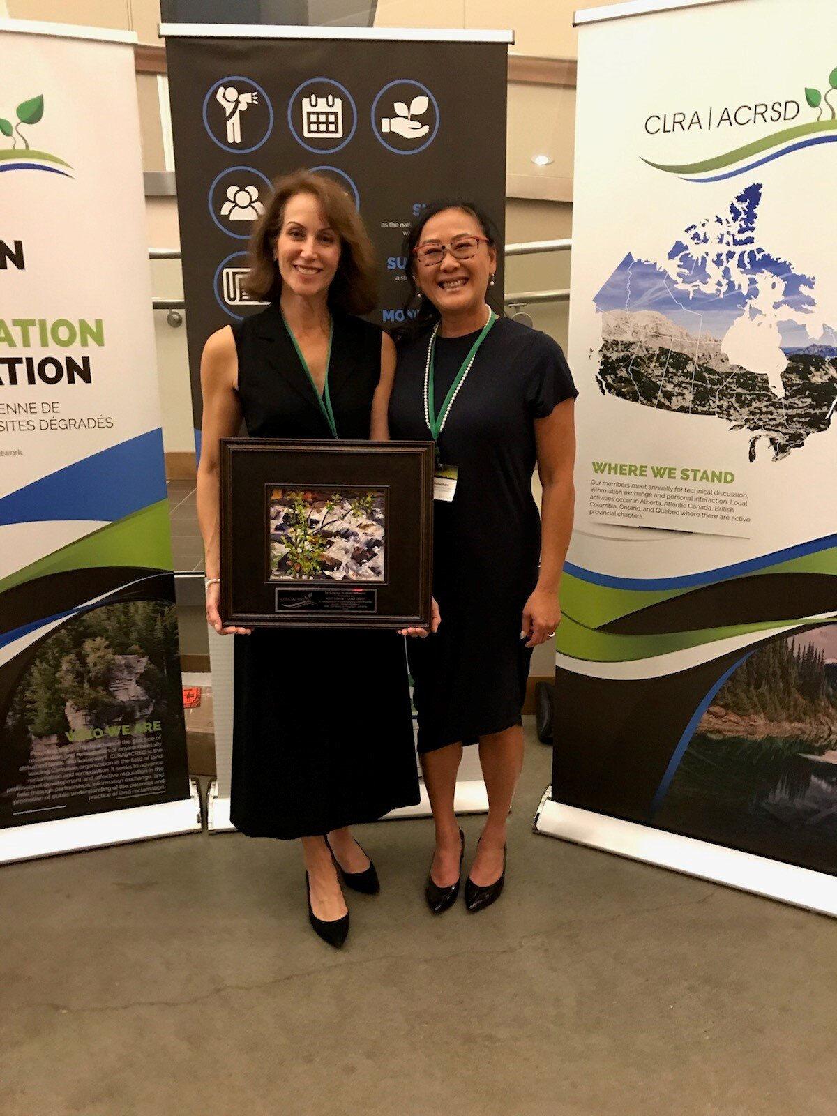 Ellen Magidson (left), accepting the Dr. Edward M. Watkin Award on behalf of Western Sky Land Trust, from Andrea McEachern (right), President of the CLRA, at the National Conference & AGM Banquet, Sept 18, 2019, Kimberley, BC