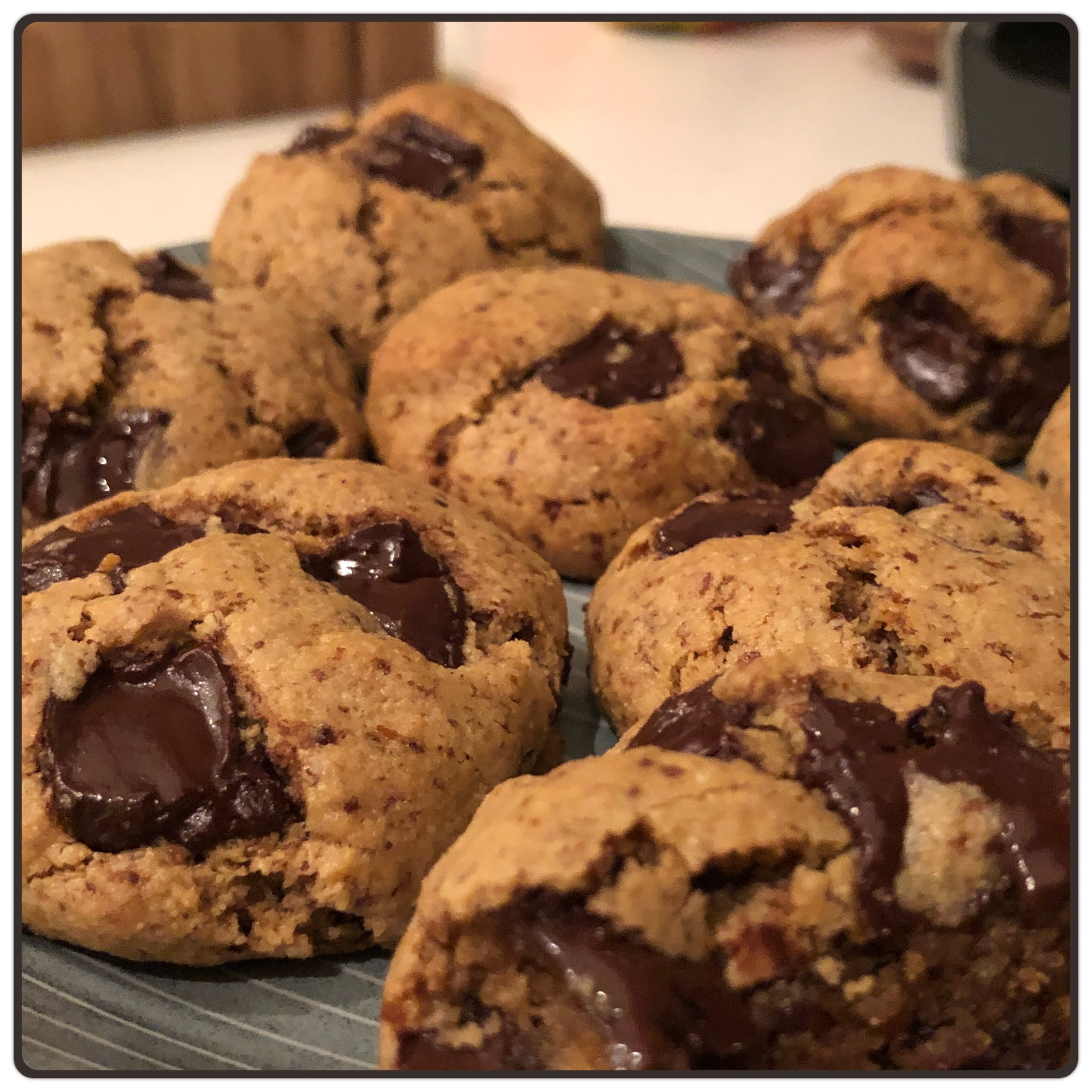 Chocolate Chip Cookies   Dry Ingredients:  1 1/2 cups Almond Flour 2 tbsp Coconut Flour  1/3 cup Coconut Sugar 1/2 tsp Baking Soda 1/4 tsp Salt 1/2 cup Chocolate Chips (60% or higher)  Wet Ingredients:  1/2 cup Butter (melted) 1  Egg 1 1/2 tsp Vanilla Extract  Directions:  1. Preheat oven to 350 degrees F, grease baking sheet or line with parchment paper.  2. Combine all dry ingredients except chocolate chips in a large bowl.   3.  Melt the butter and combine with the egg and vanilla extract in a small bowl.    4. Combine wet and dry ingredients in the large bowl and add chocolate chips.                            5. Roll the dough into balls approx. 1 inch in diameter, place on baking sheet. 6. Bake for 12-15 min, let cool.