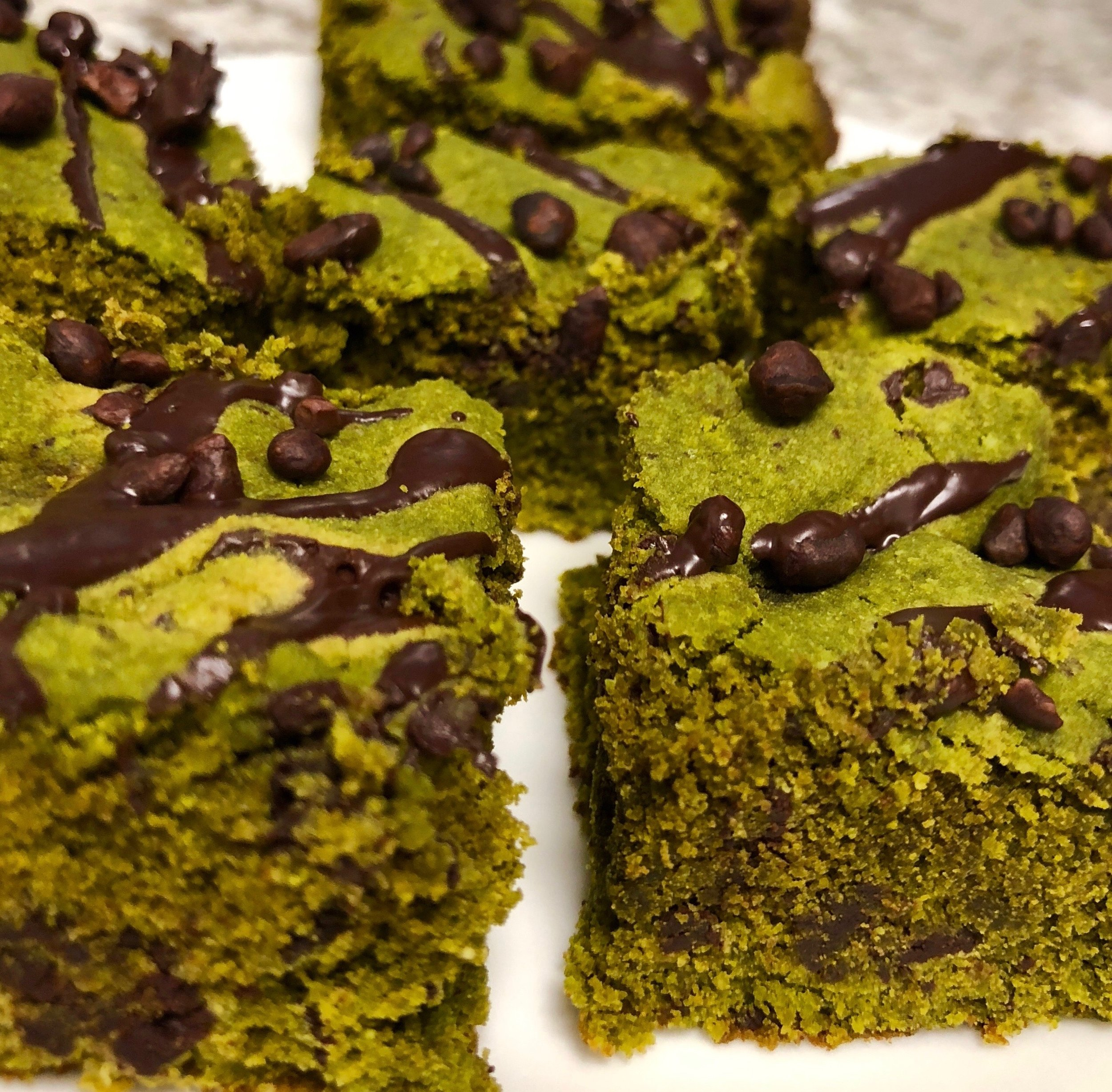 Matcha Mint Brownies    Dry Ingredients:   1/2 cup almond flour  1 cup coconut flour  1/4 cup matcha powder  1/2 tsp baking soda  1/4 tsp salt  1/2 cup dark chocolate chips, or chopped up dark chocolate chunks   Wet Ingredients:   1/2 cup butter (softened)  2 eggs  2 tbsp coconut oil  3 tbsp agave syrup  1/2 tsp vanilla extract  1 tsp peppermint flavor (I used Frontier CO-OP brand)   Toppings:   2 oz dark chocolate (85% - 90%)  1/4 cup cacao nibs     Directions:   1. Pre-heat the oven to 350 degrees °F. Grease an 8X8 pan and set aside.  2. In a large bowl combine dry ingredients, add in wet ingredients and mix until well combined. Add in the chocolate chips at the end.  3. Pour batter into greased pan and bake for 15-18 minutes, or until a toothpick comes out clean. Let cool on a baking rack.  4. Melt the dark chocolate over low heat.  5. Once cooled, drizzle chocolate over brownies and sprinkle with cacao nibs.