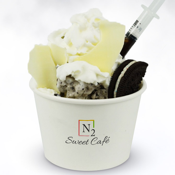 Black & White - A true ice cream classic.Base: Vanilla ice cream mixed with Oreo piecesToppings: White chocolate pieces, whipped cream and an Oreo cookie