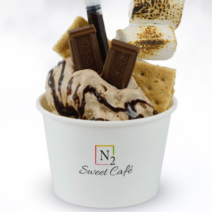 The Camper - The taste of campfire stories and outdoor fun.Base: Chocolate ice cream mixed with graham crackerToppings: Toasted marshmallow, Hershey's chocolate and graham cracker