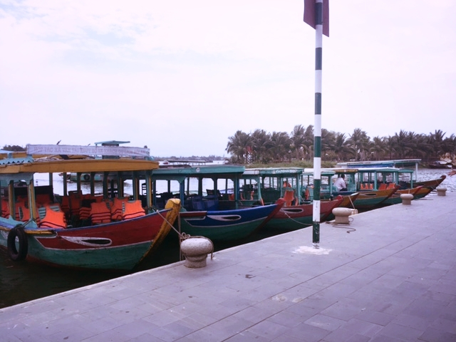 Tour boats lined along the main dock.
