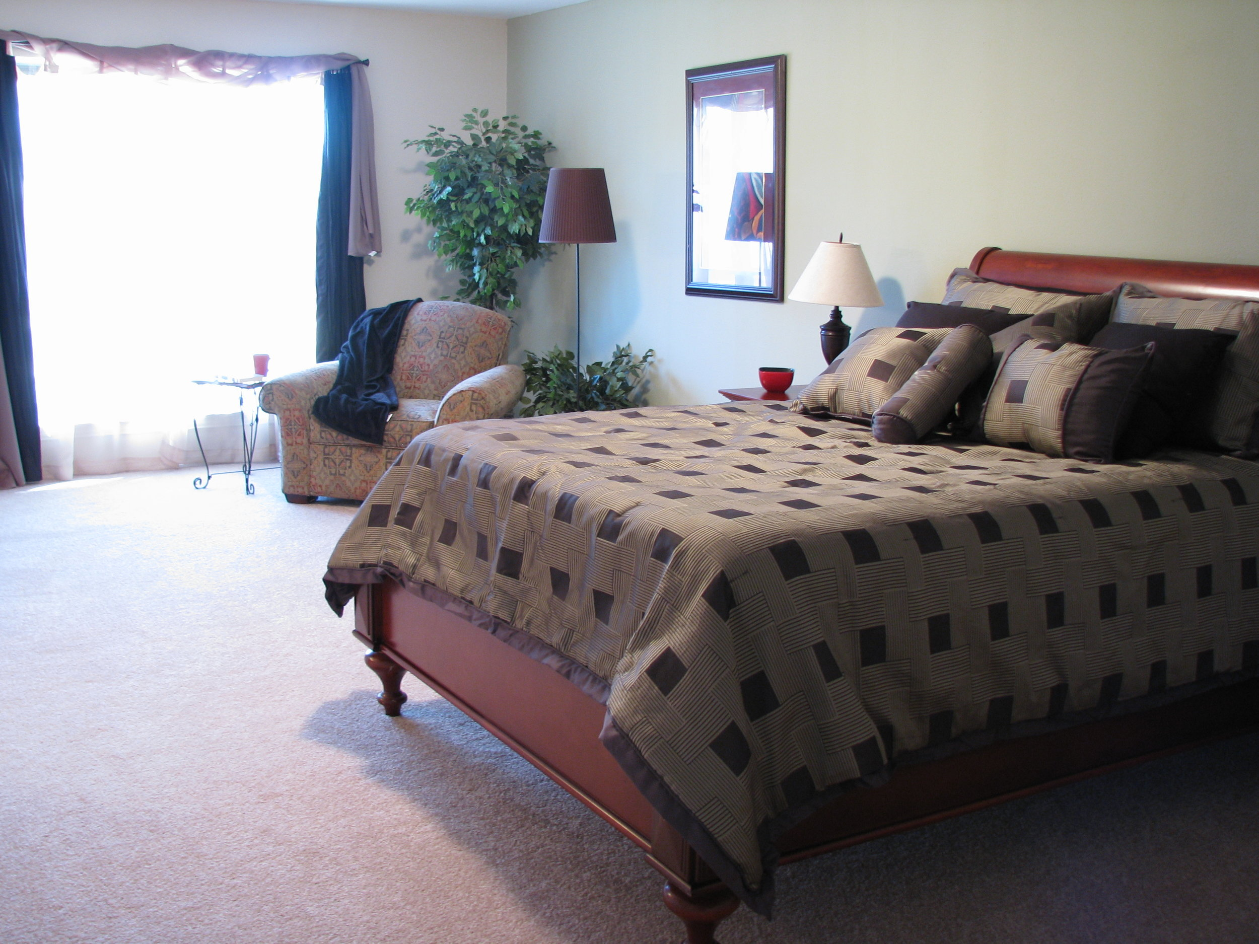 Master bedroom after new paint, carpet, window coverings and of course staging