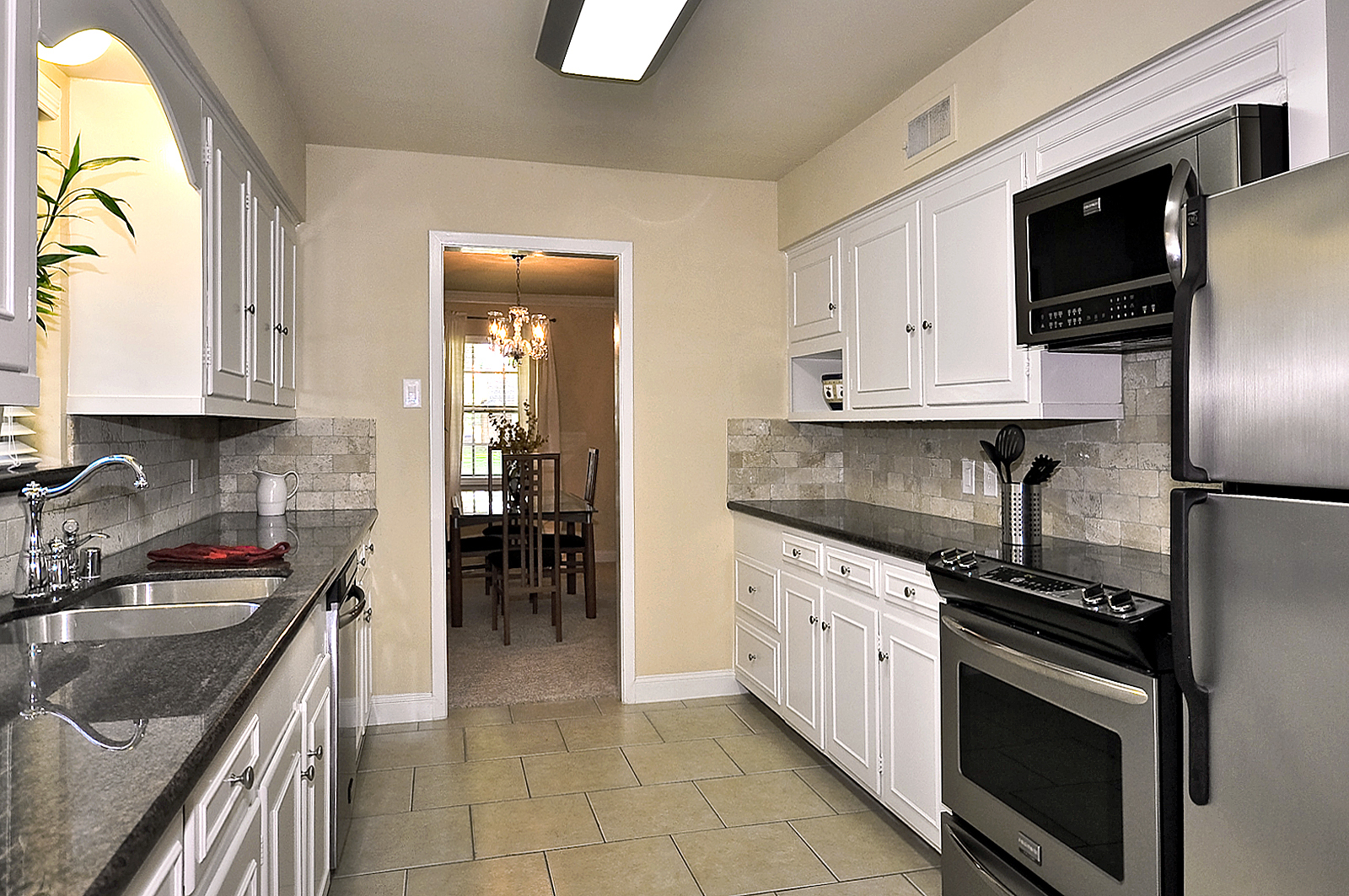 3208 Chapel Downs Dallas Kitchen from Utility.jpg