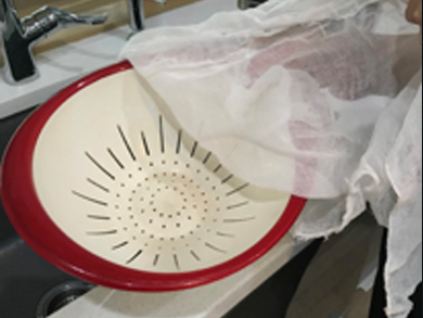 Step 5    Prepare the gauze by placing it over a colander.