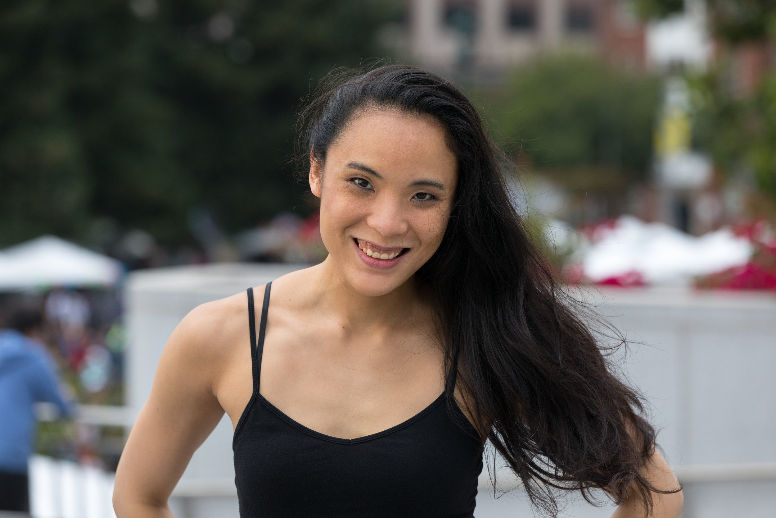 """Dian Sitip Meechai  is a singer, dancer, contortionist, and choreographer. She joins the v2 team as a Dance Co-Captain and part of our talented ensemble. She has done commercial and performance work for Kinda Funny Live, Silversea Cruises, SEGA, and Earth Circus. Born in the """"Boogie Down"""" Bronx, Dian aspired to perform from her earliest days. She sang at city wide and regional events in her youth. While majoring in Computer Science at Northwestern University, she minored in Vocal Performance and competed in their DanceSport team. Upon graduating, Dian branched into contortion and dance styles like jazz, hip hop and contemporary. Dian's vocal repertoire includes jazz, classical and musical theater. She recently played The Girl and was dance captain in Landmark Musical Theatre's Roar of the Greasepaint, Smell of the Crowd. Other credits include singing onboard the international-sailing Silver Spirit, choreographing for the 2017 Nitey Awards and contorting at various Bay Area dinner theaters. She's pumped to join the SOMA v2 cast!"""