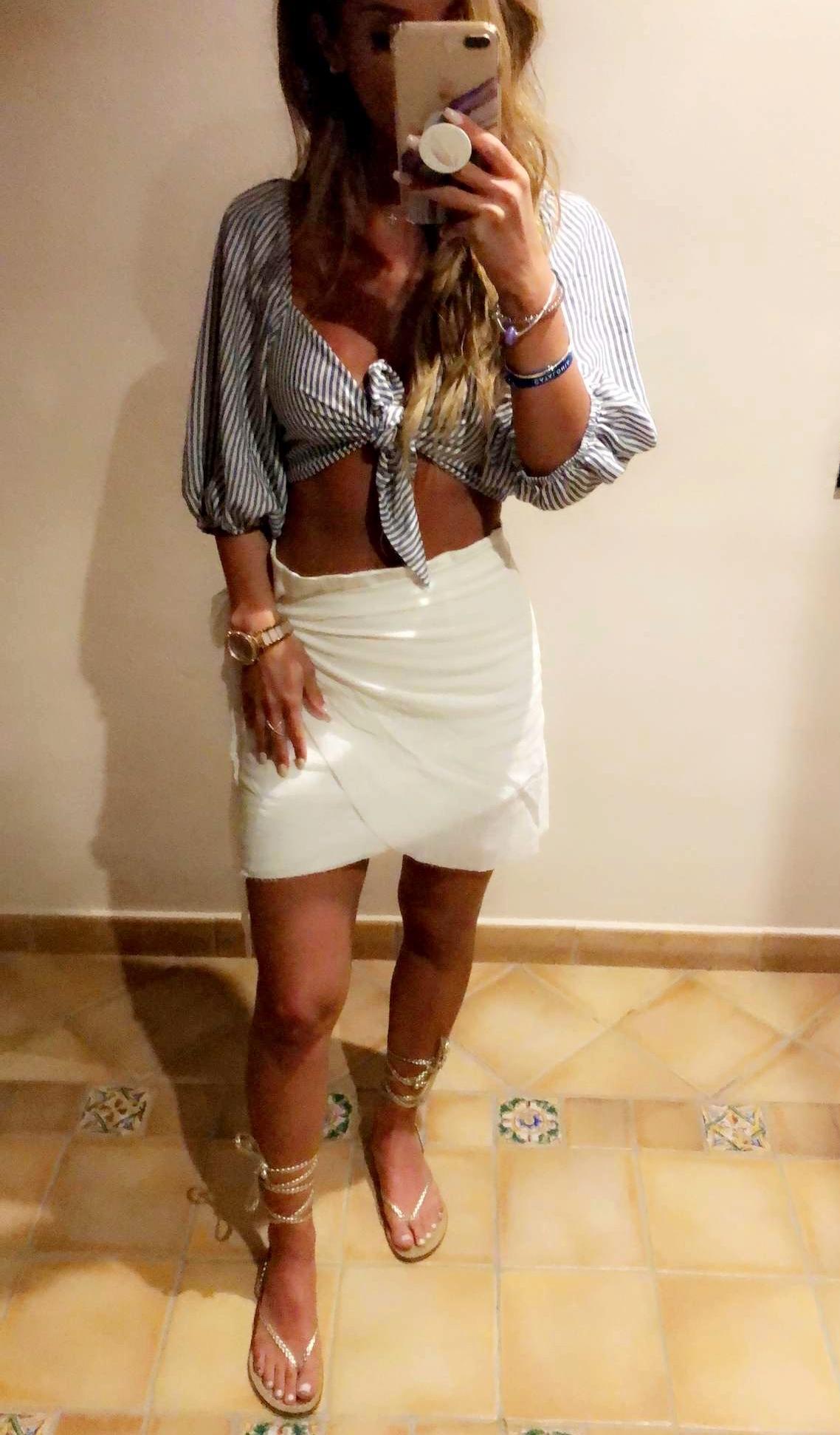 Top:  Mystique Boutique NYC   Skirt:  White Fox Boutique   Watch:  Michael Kors