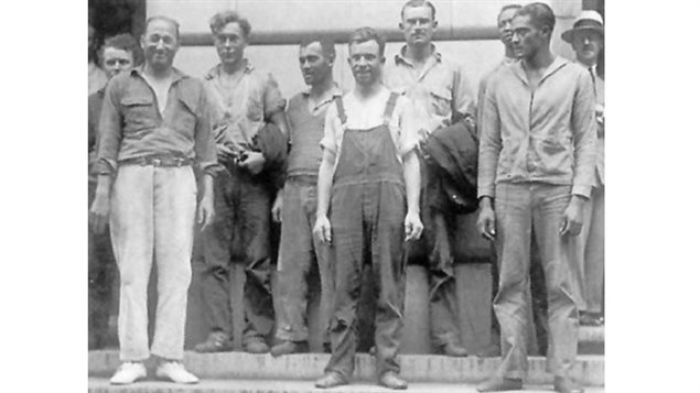 The crew of the I'm Alone, minus one boatswain. Captain Randell on the left in wehite pants.