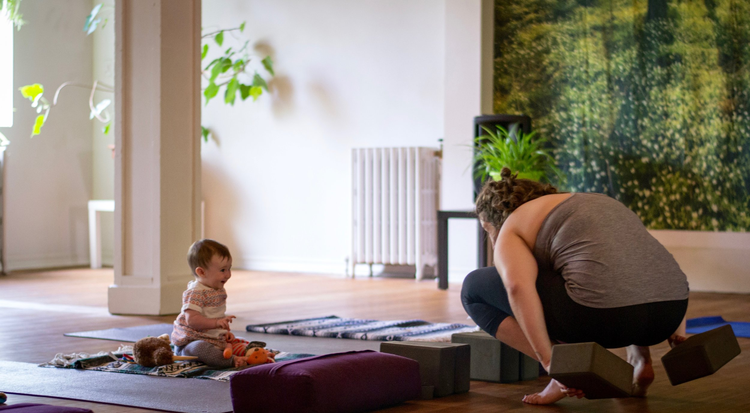 Kira setting up for a Parent and Baby class at  Yoga Village , with my kid, Juniper (9 months).