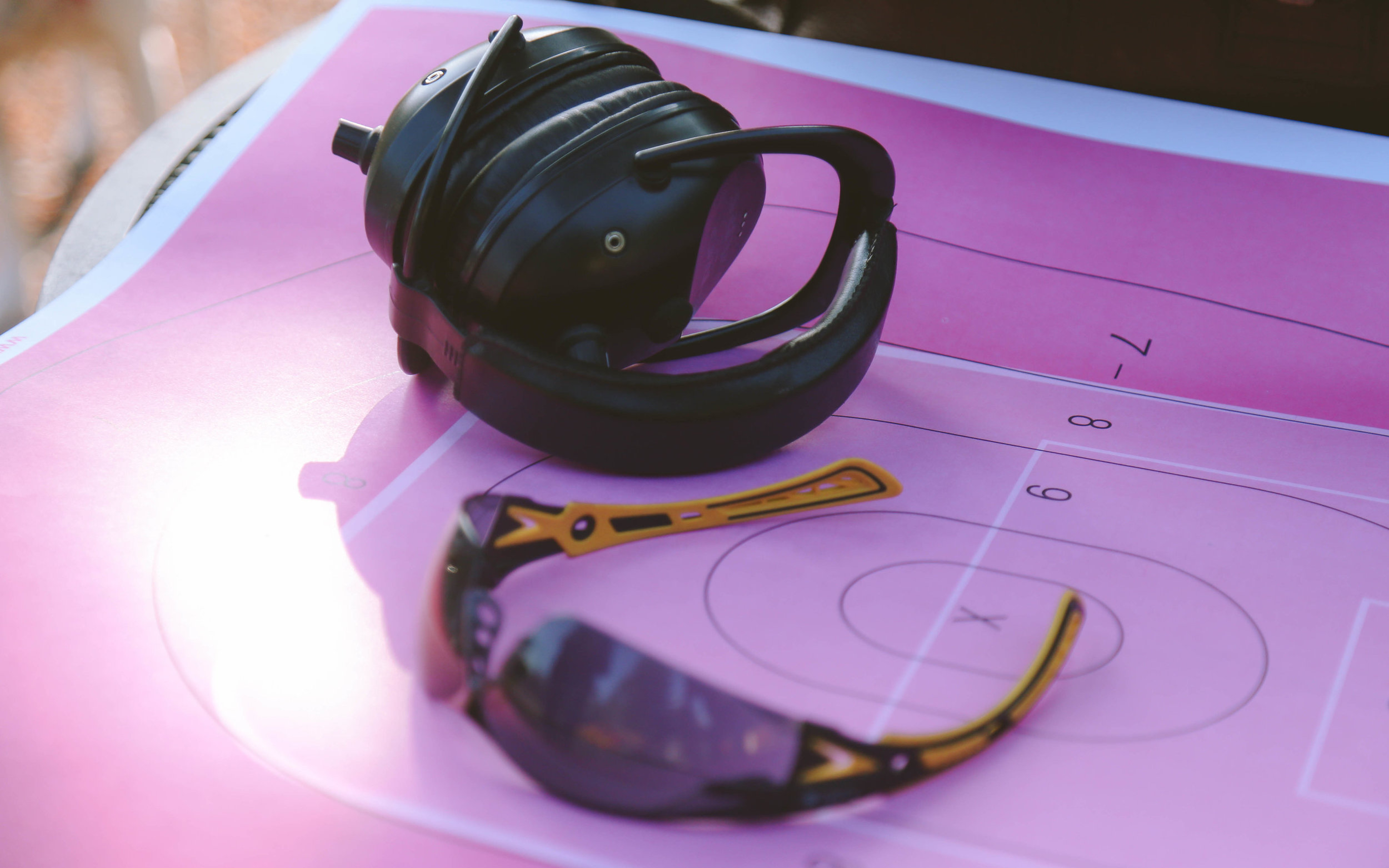 Proper ear and eye protection is required for safety while attending classes with Carol and The Cognitive Defender.