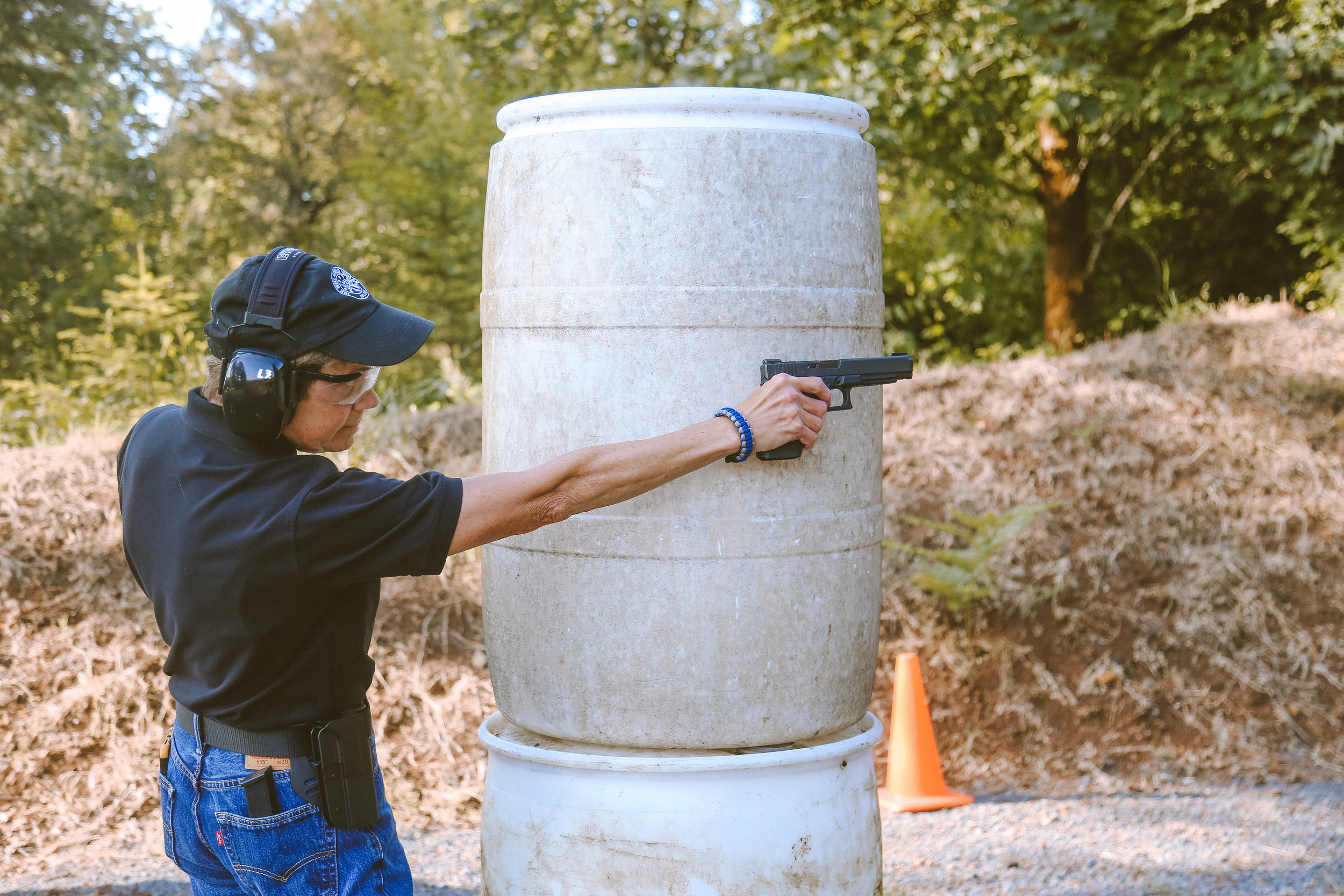Carol Demonstrates Proper Form at the Firearm Range