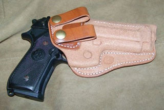 This Beretta M9 is kept at home ready in a Milt Sparks Summer Special holster