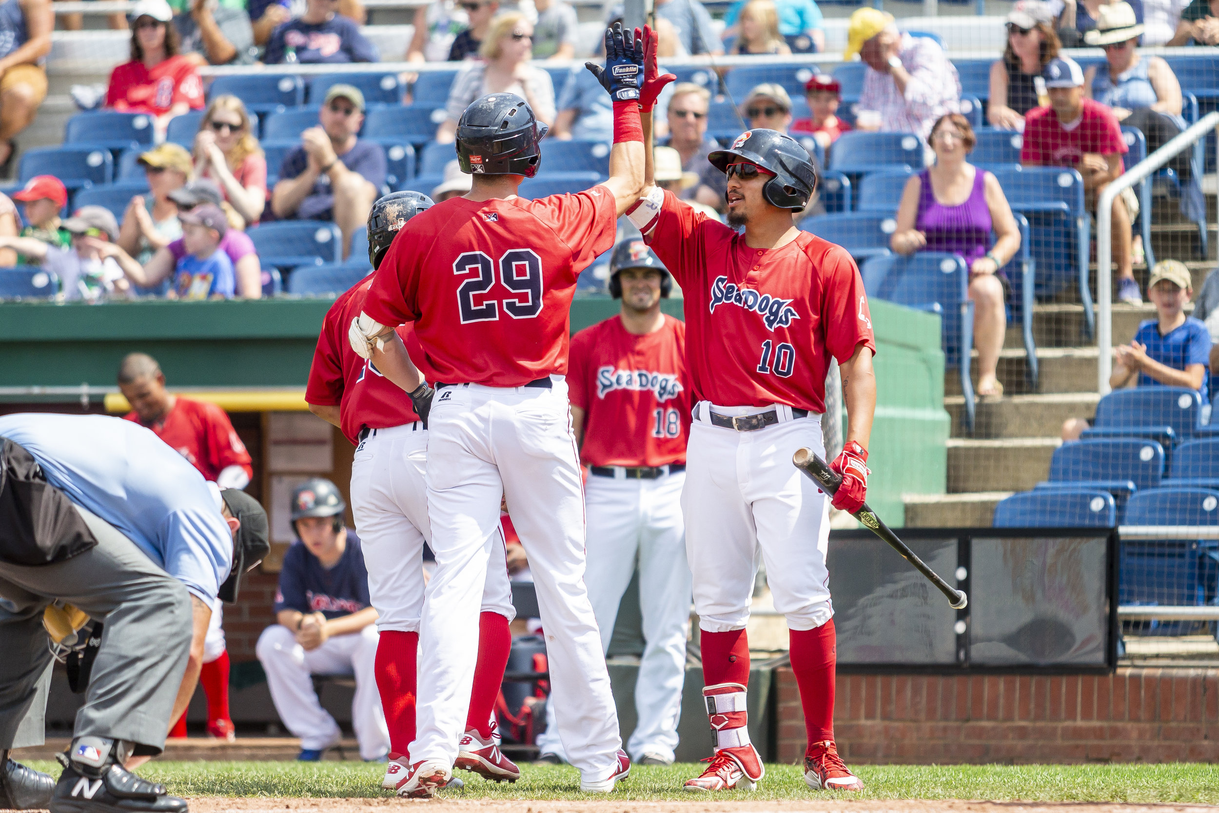PORTLAND, ME - AUGUST 05:  Bobby Dalbec #29 of the Portland Sea Dogs is congratulated by his teammates after hitting a two-run-home-run in the game against the Richmond Flying Squirrels on August 5, 2018 in Portland, ME at Hadlock Field . (Photo by Zachary Roy/Getty Images)