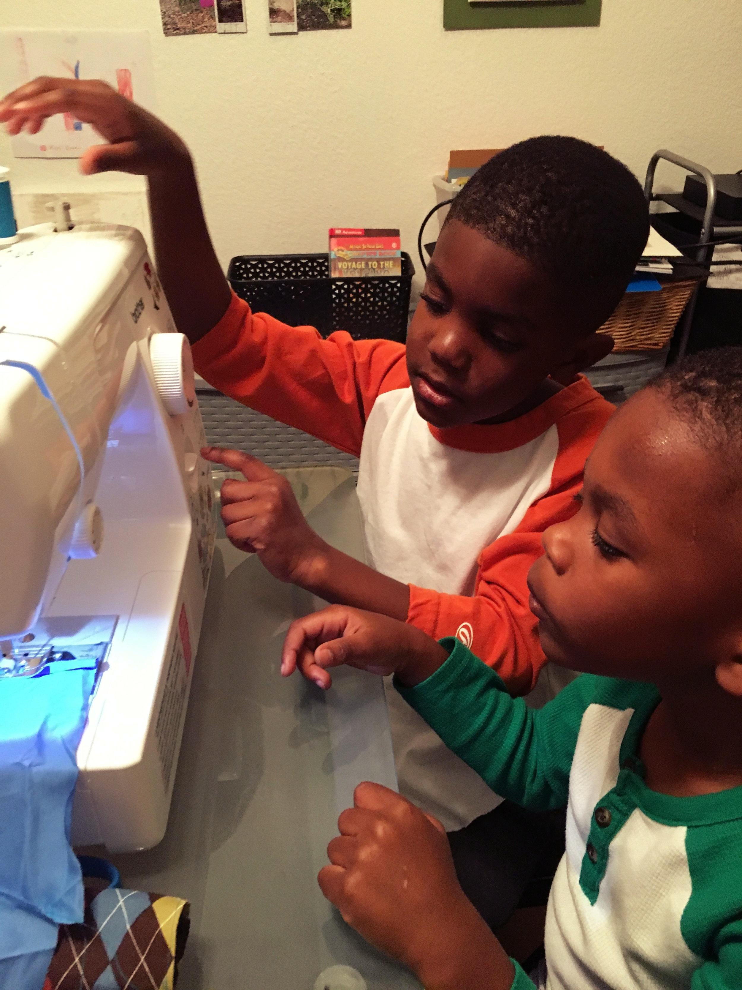 They loved trying to figure out the mechanics of the sewing machine!Too bad I didn't have a big sewing project going on at at the time!
