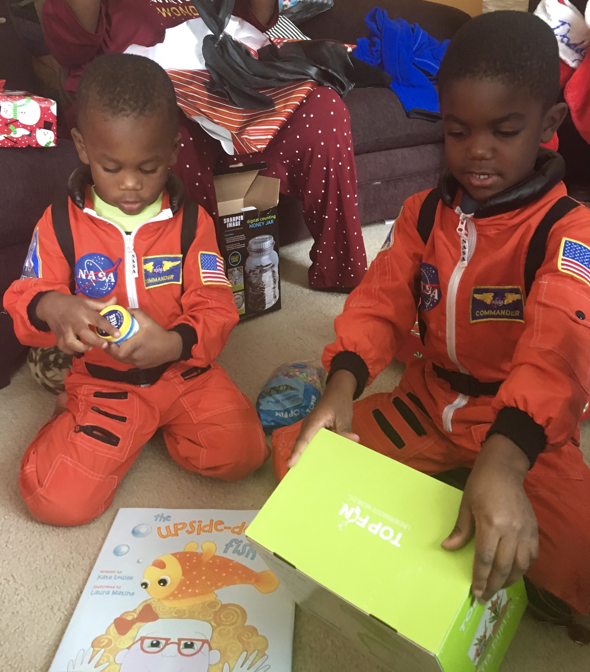 Who wants to open Christmas presents in matching pjs when you have matching space suits?!