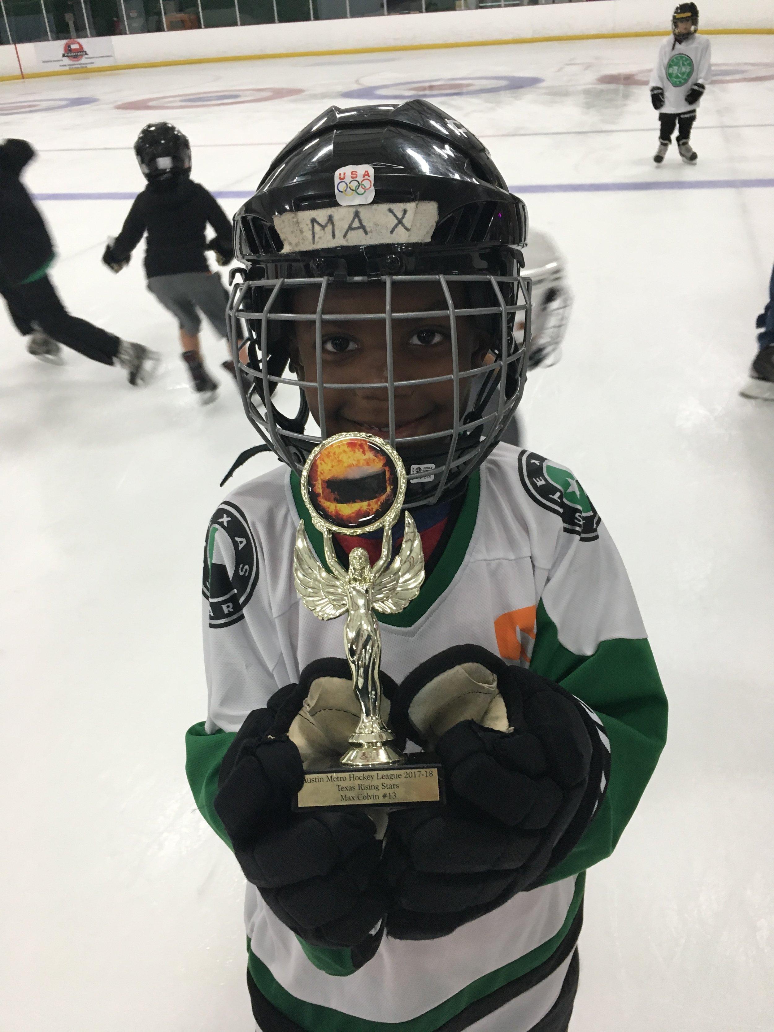 Max plays hockey