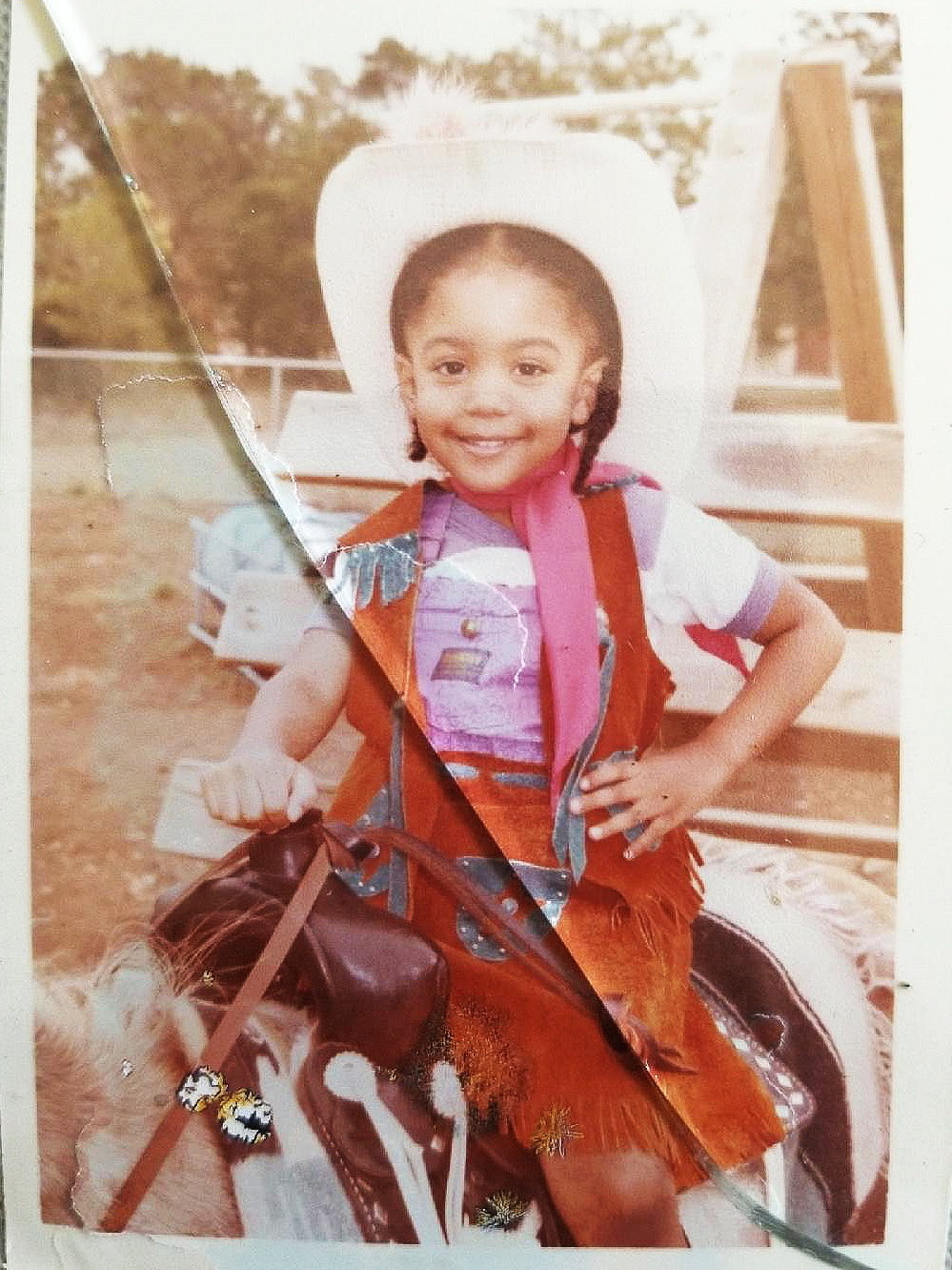 Me on a pony at my pre-school 's Cowboy/Cowgirl Day a LOT of years ago!