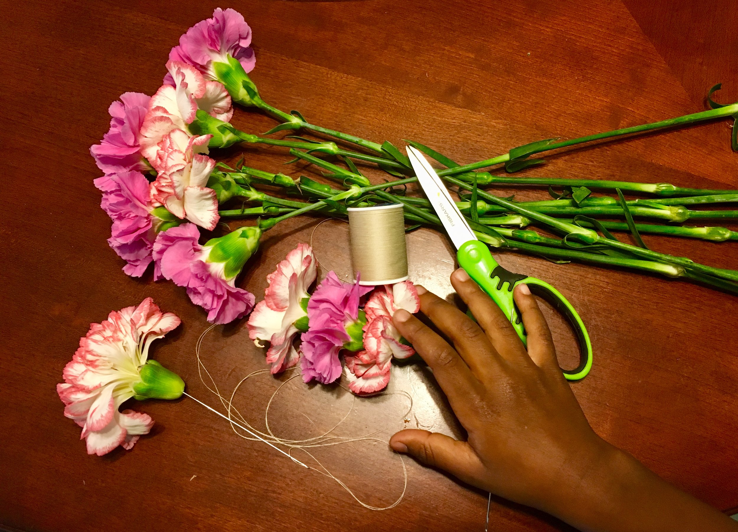 Making a lei is pretty easy! Supervise the littles with those needles though!