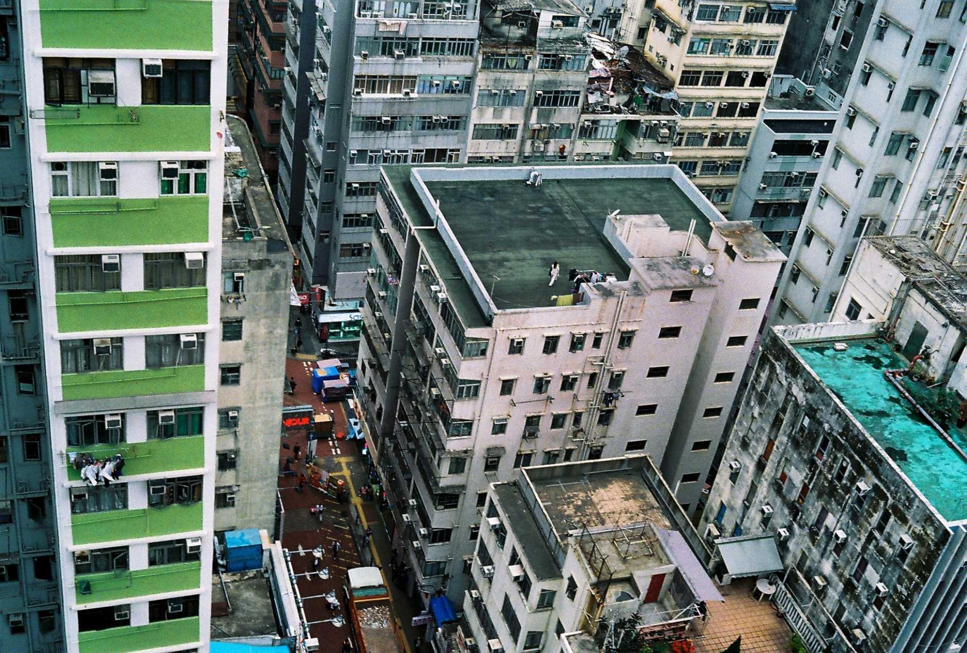 Bringing the washing in. Mong Kok, Hong Kong. 2015