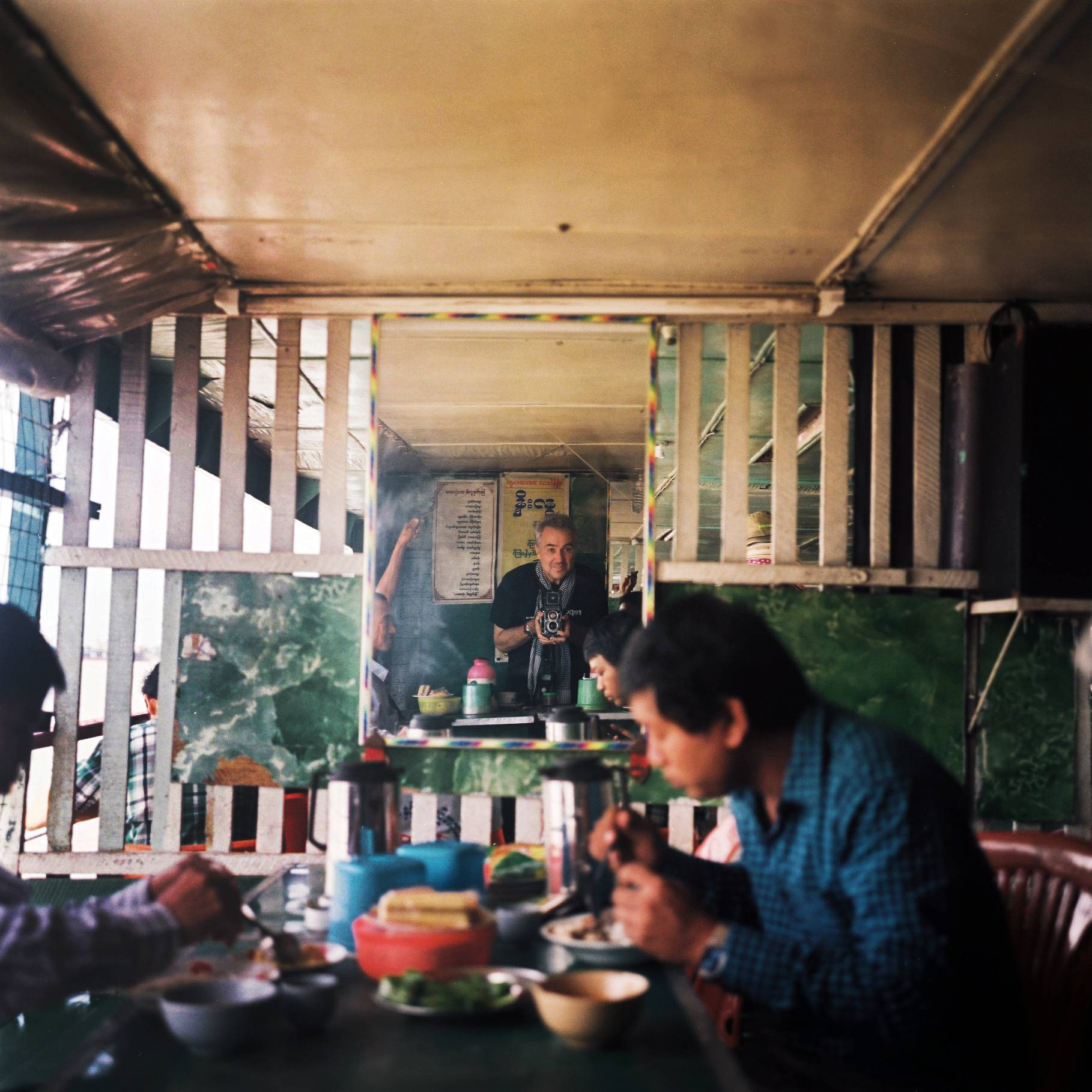 Jack Picone (self-portrait) with Rollei. Crossing the Rangoon River. Yangon, Myanmar. 2014