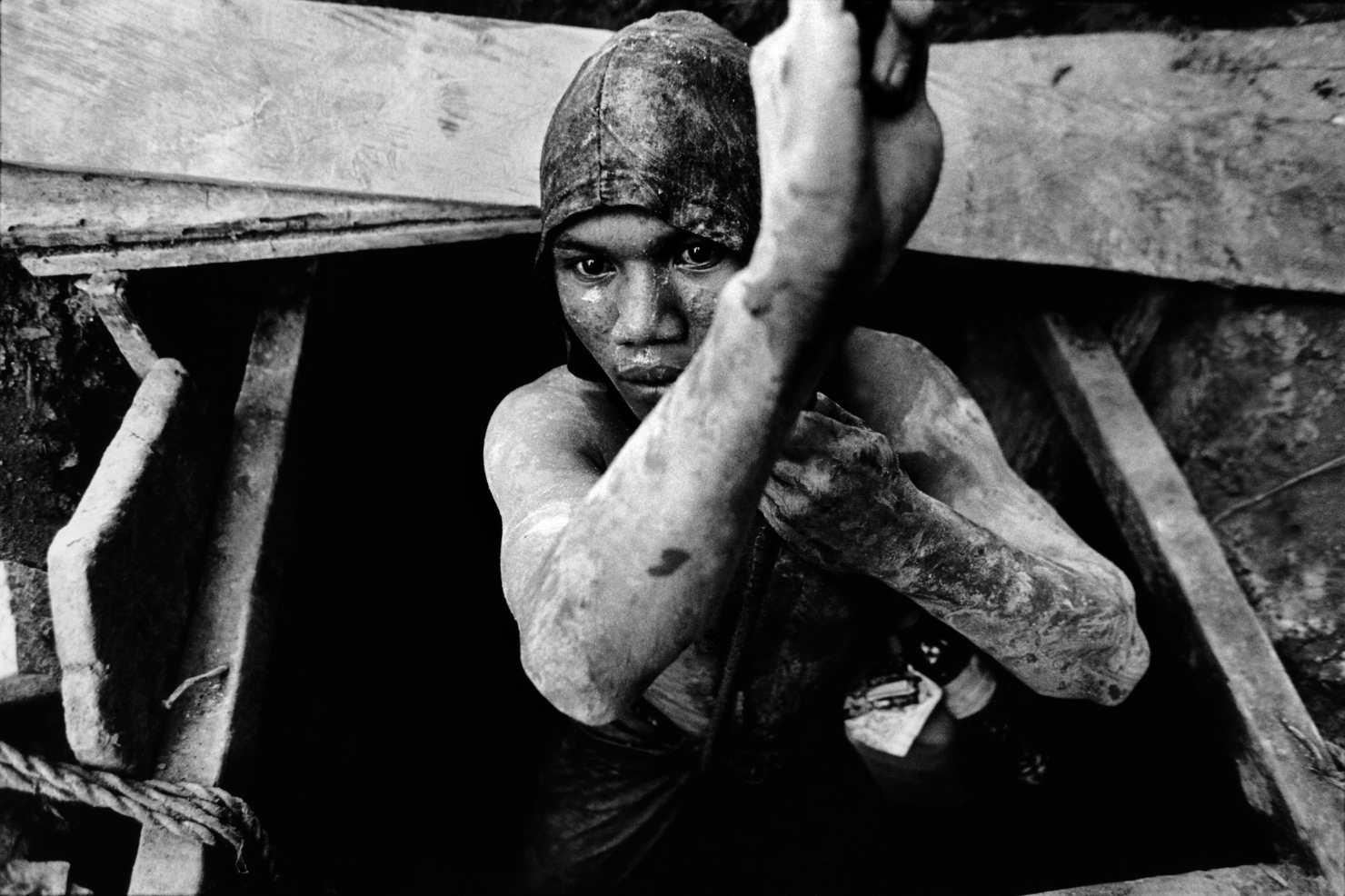 Gold miner.Sulawesi, Indonesia. 2002