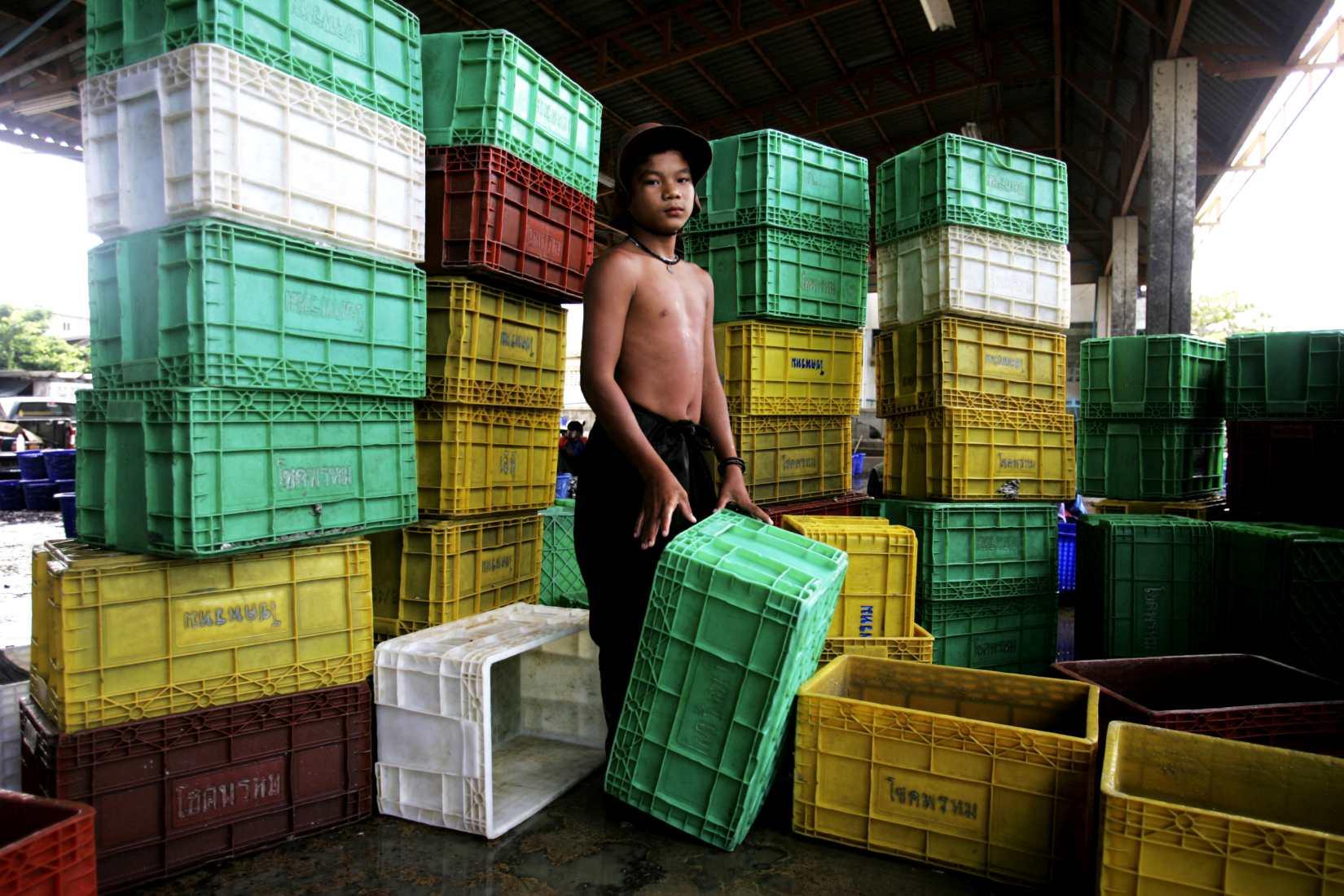 """Child laborer"" Samut Sakorn fishing docks, Thailand. 2009"