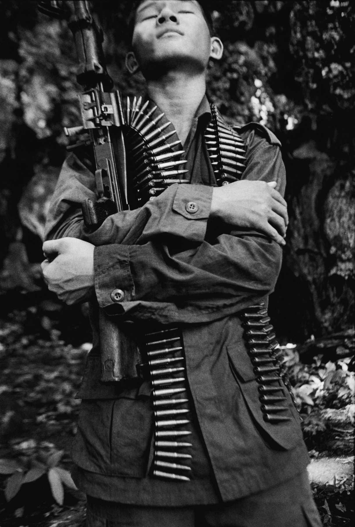 """""""Malaria"""" KNLA rebel soldier in the jungle. Thai-Burma border. 2005"""