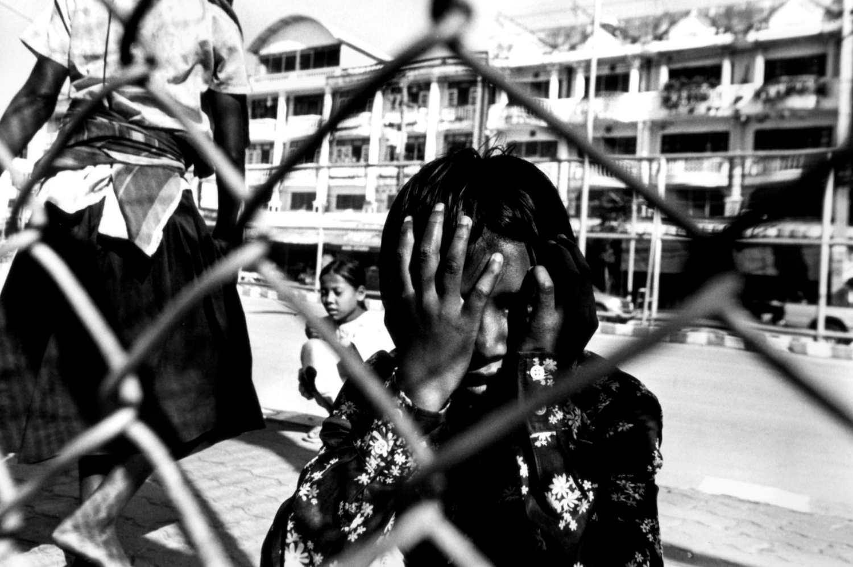 """Waiting for Work"" Child porters on The Friendship Bridge Mae Sot, Thailand. 2004"