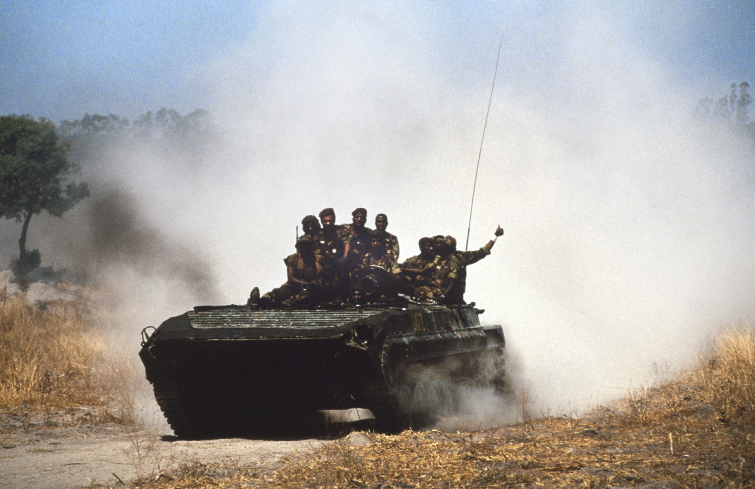 A tank and crew returning from the frontline during Angola's brutal civil war. Quito, Angola, 1993