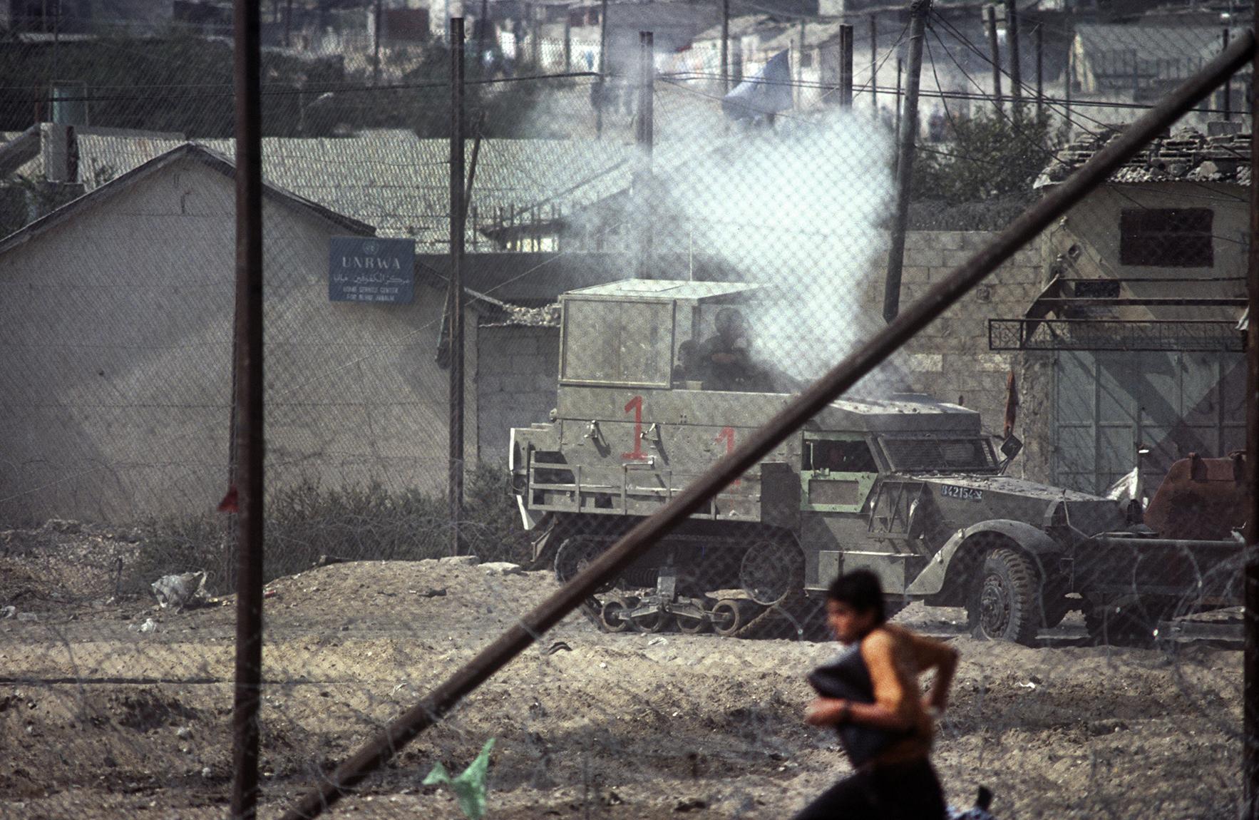 "A ""Stone Canon' shoots stones at a Palestinian boy.First Intifada. Gaza Strip, 1992"