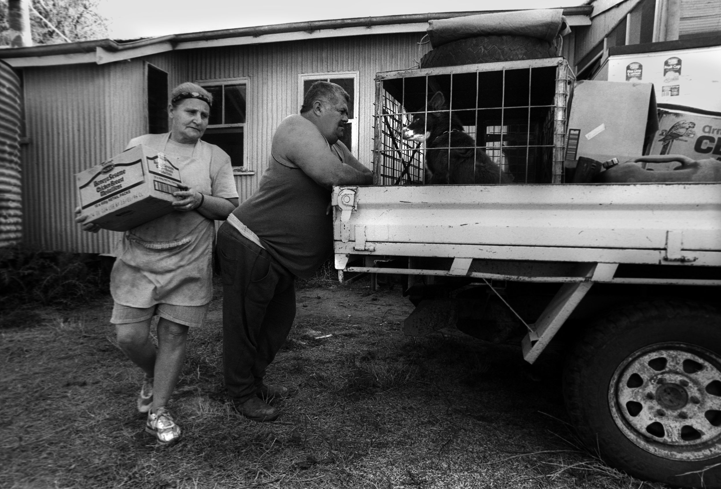 The shearer's cook and her husband pack the 'ute' (utility truck) before travelling to the next sheep station. Outback QLD, Australia. 1997